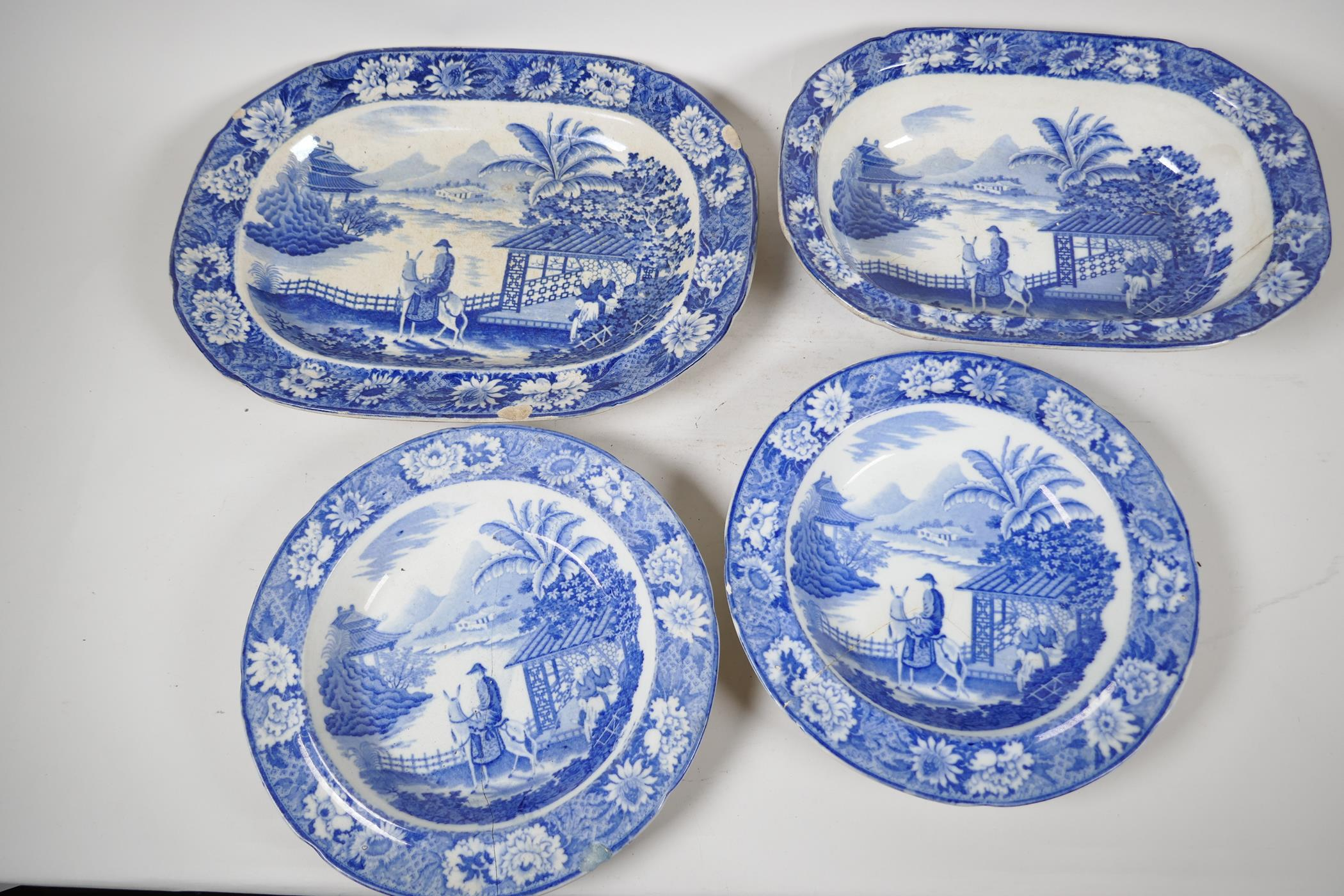 """C19th blue and white pottery 'Man on Donkey' pattern meat dish, 14"""" x 11"""", oval serving bowl and two"""