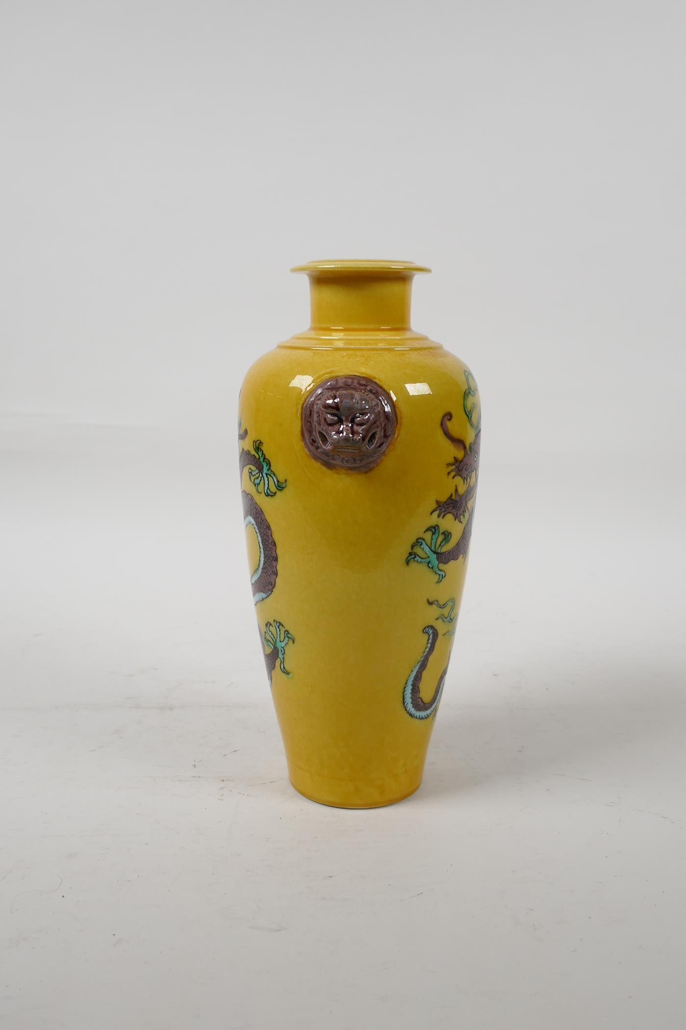 A Chinese Sancai glazed porcelain vase with two lion mask handles and dragon decoration, six - Image 2 of 5