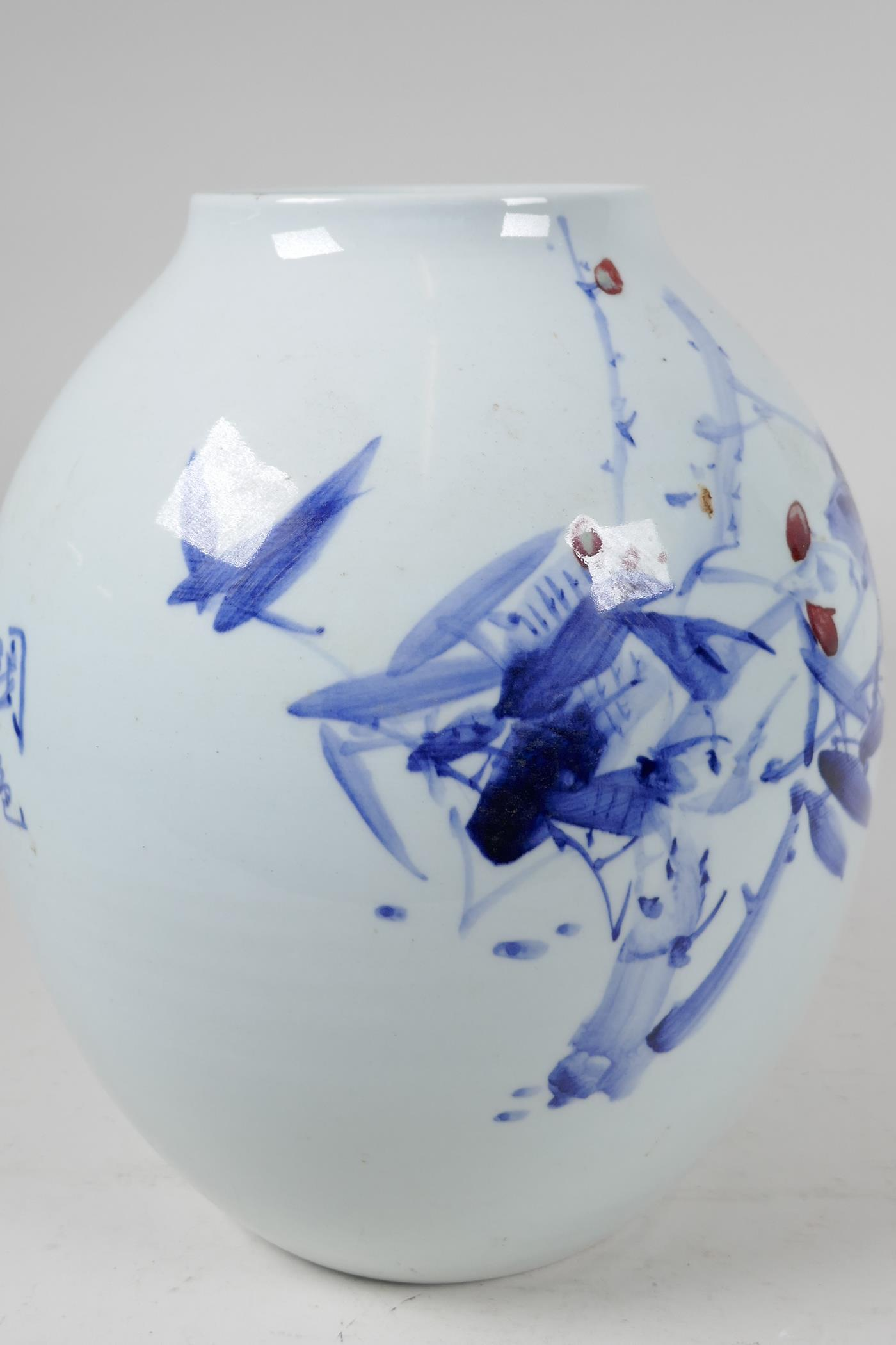 A Japanese porcelain vase decorated with stylised flowers in blue and red with character - Image 3 of 5