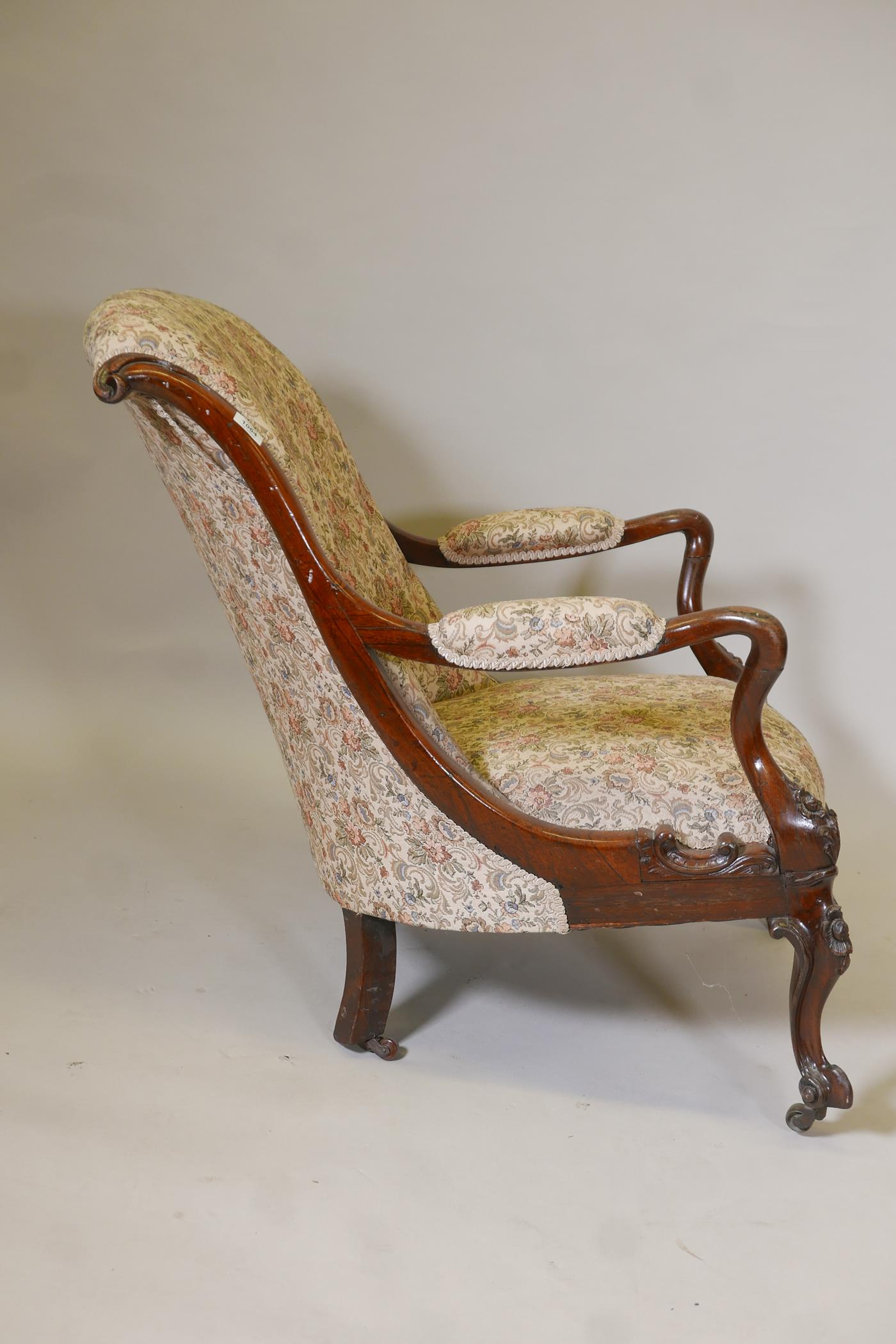 A Victorian rosewood show frame open arm easy chair, with scrolled back and shaped arms, raised on - Image 7 of 7