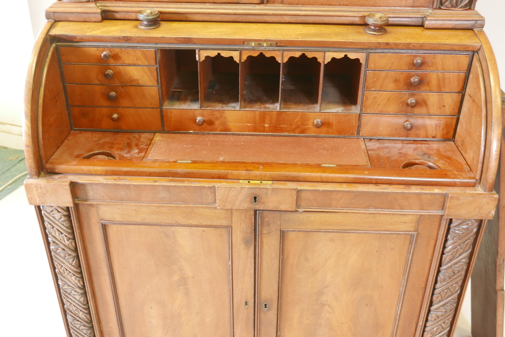 A Victorian cylinder top bureau bookcase, the upper section with two glazed doors and carved - Image 4 of 6