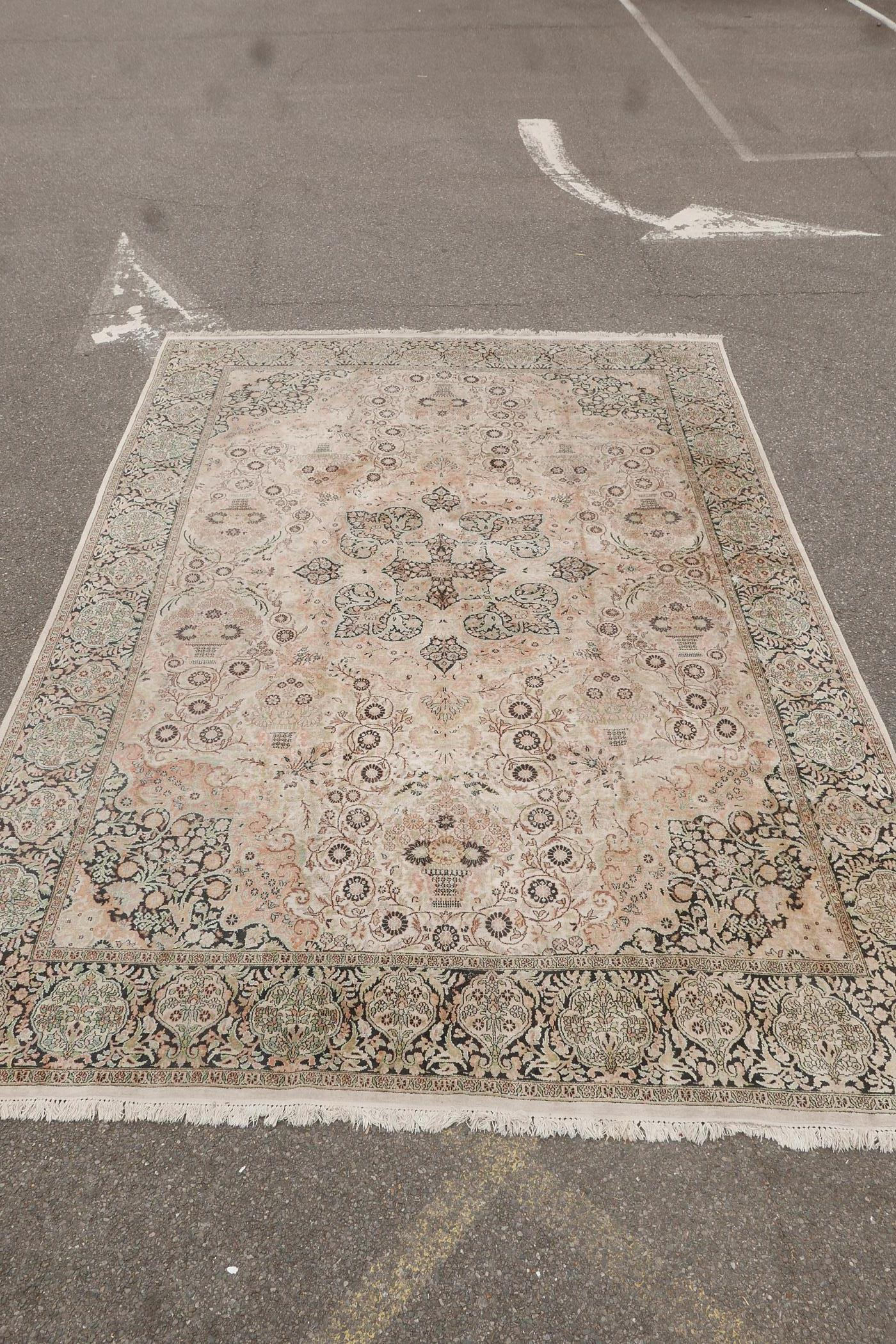"""An oriental ivory ground silk carpet, with multicolour floral decoration within a black border, 151"""" - Image 3 of 6"""