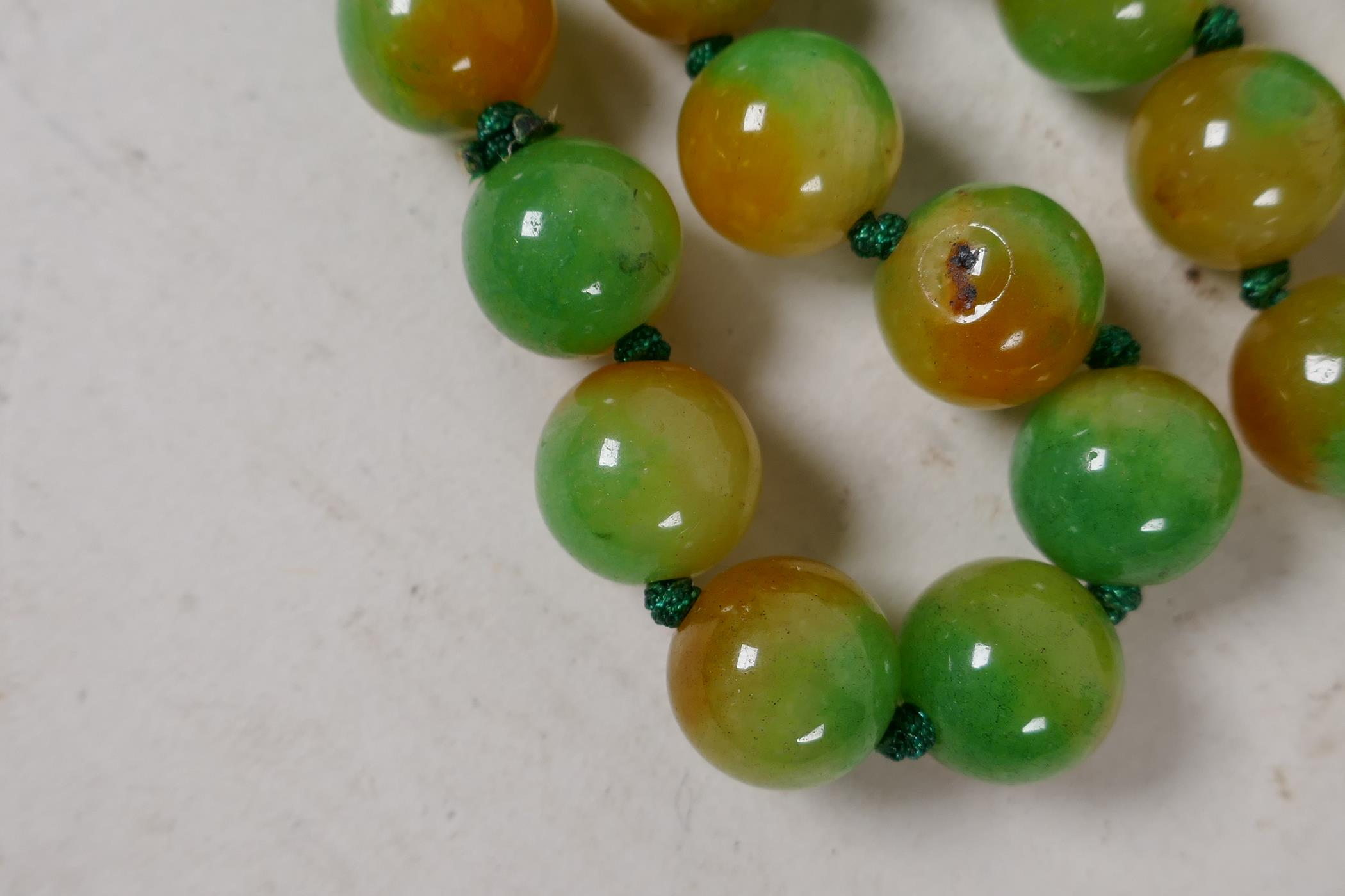 """A string of 60 two colour jade beads, 32"""" long - Image 2 of 2"""