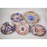 """A C19th Imari porcelain charger painted with figures 12"""" diameter, together with an oval dish"""