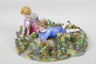 """A mid C20th Crown Staffordshire figure, children in a bed of flowers, modelled by T. Bayley, 12"""""""