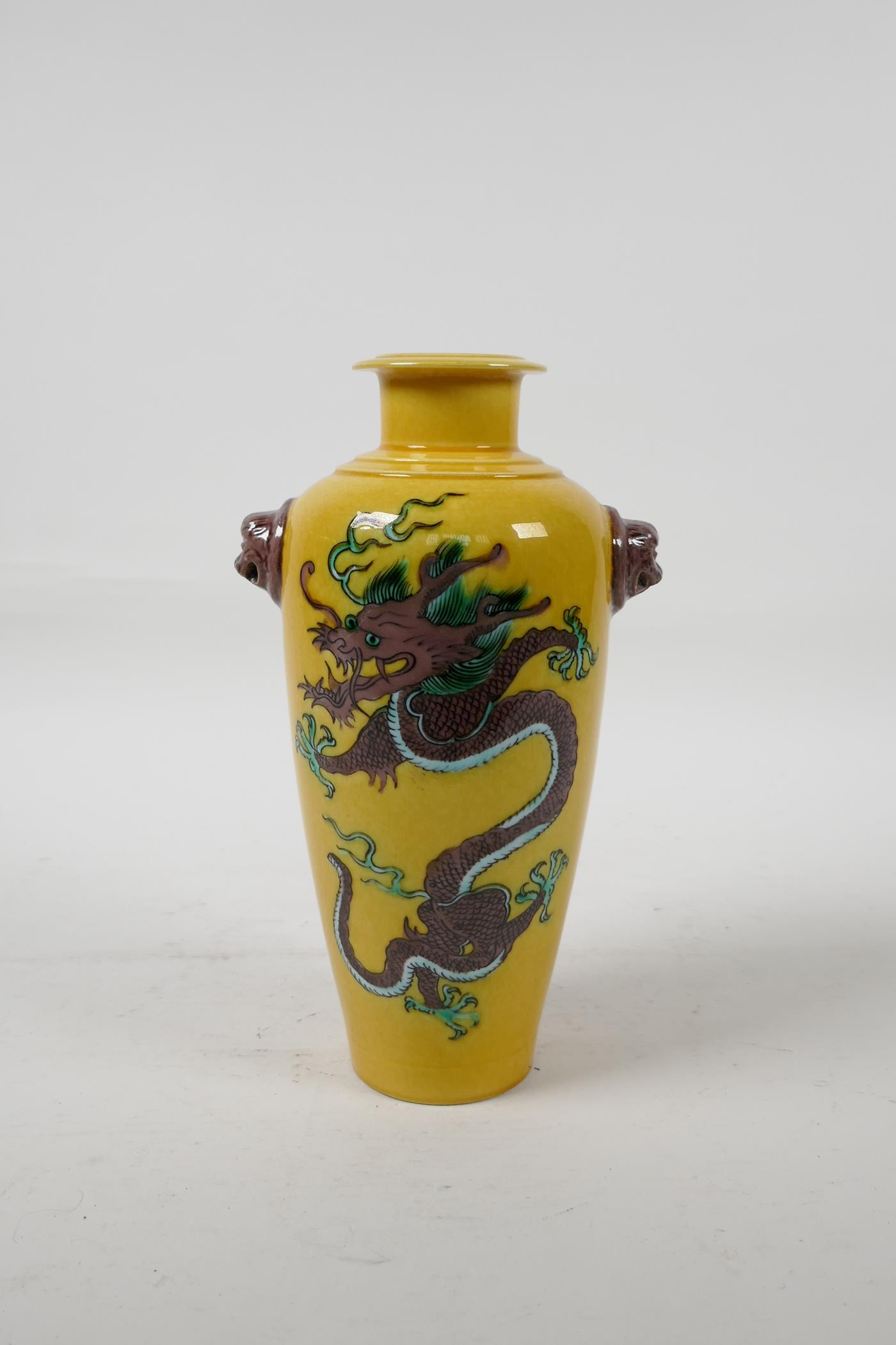 A Chinese Sancai glazed porcelain vase with two lion mask handles and dragon decoration, six
