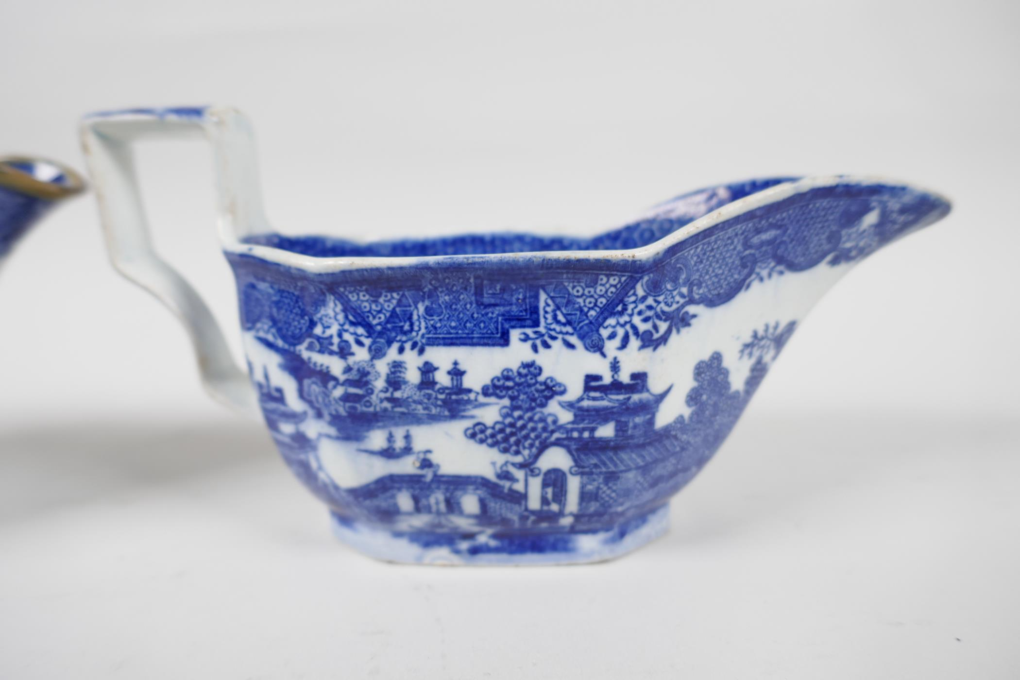 Five late C18th/early C19th English blue and white pottery sauce boats to include Boy on a Buffalo - Image 3 of 9
