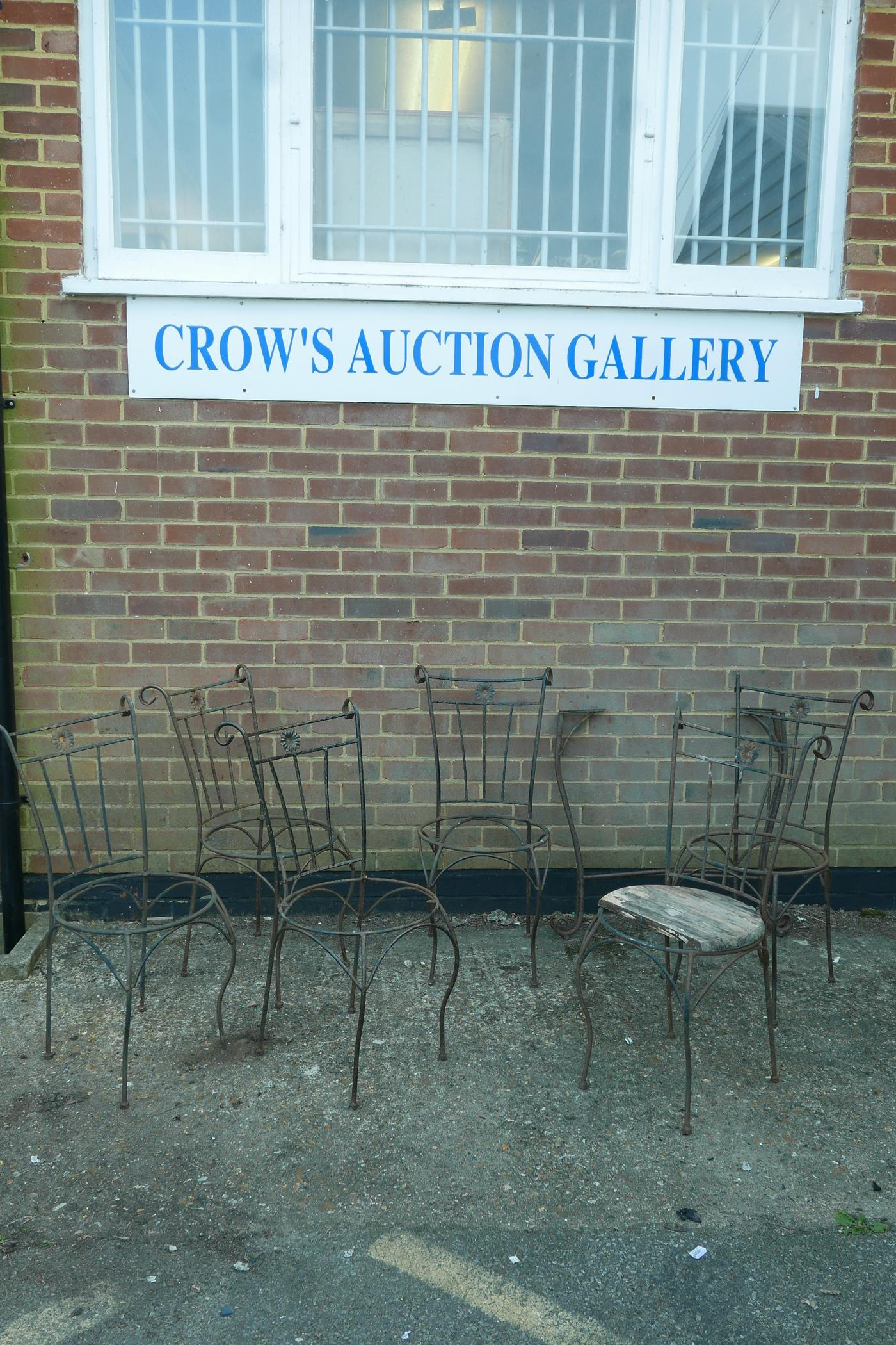 A set of six wrought iron garden chairs and matching table base, A/F, lack seats