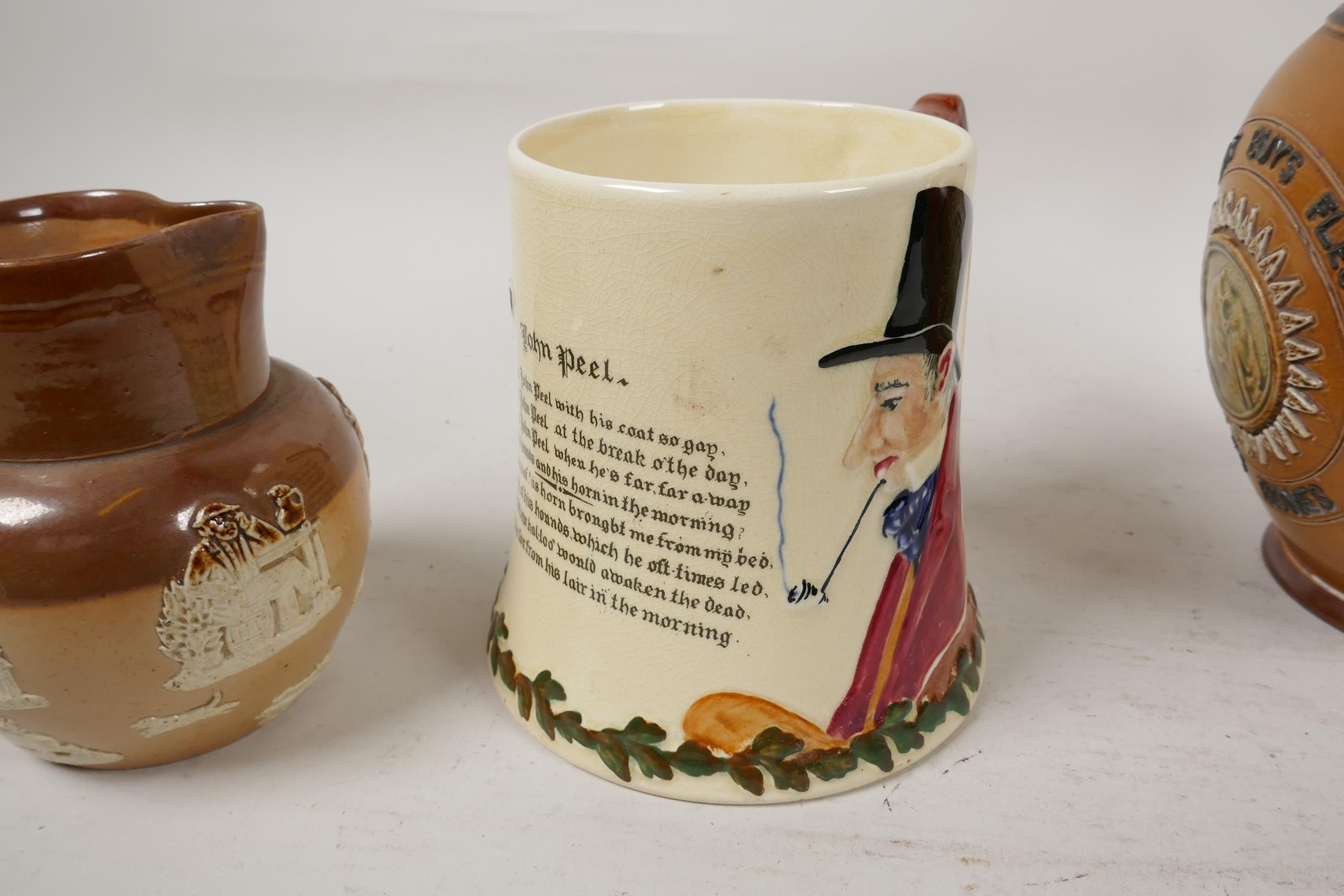 A Doulton Lambeth stoneware jug bearing the legend 'He that buys good ale' embossed with various - Image 2 of 5