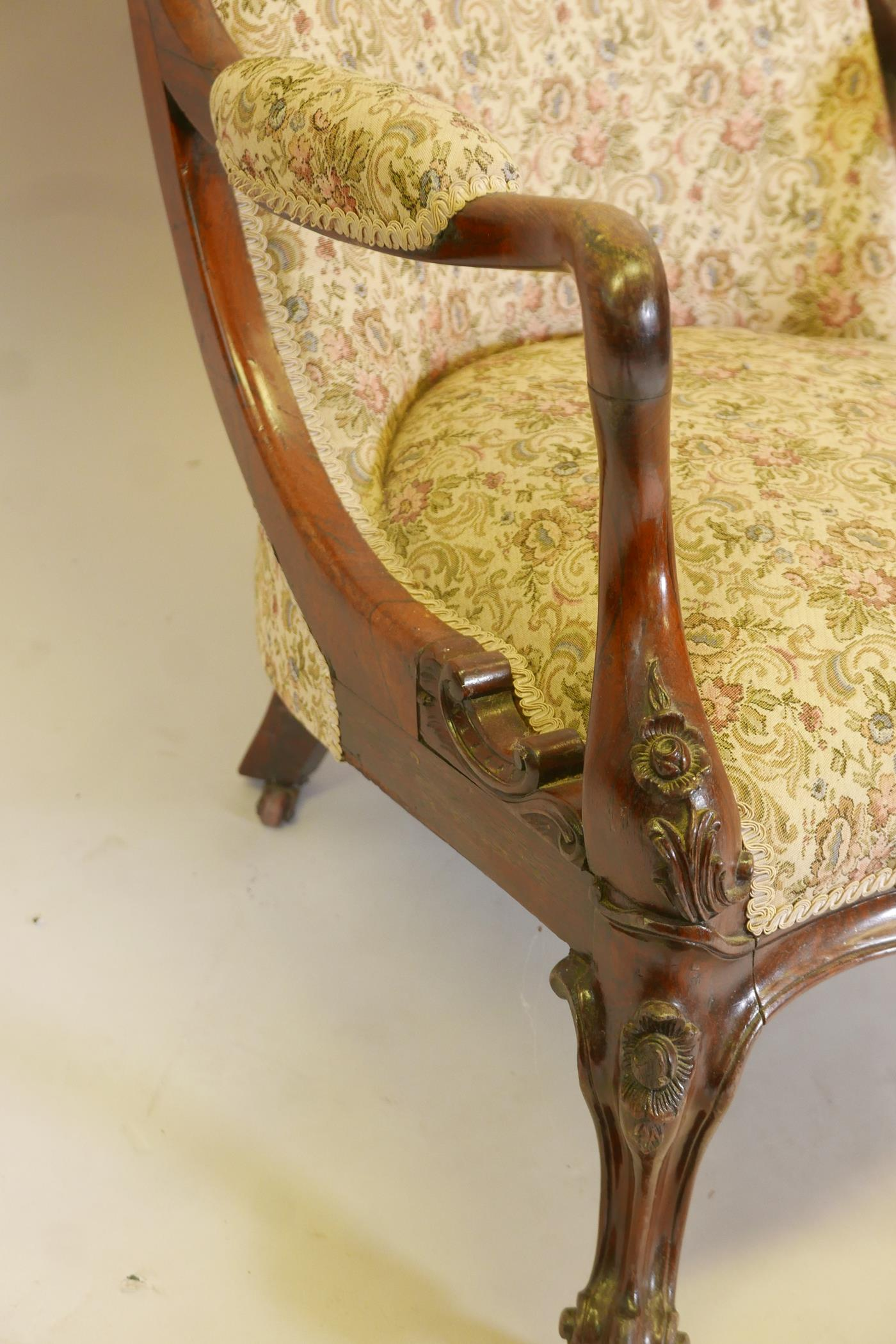A Victorian rosewood show frame open arm easy chair, with scrolled back and shaped arms, raised on - Image 5 of 7