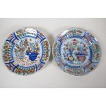 """Two C18th Delft dished plates painted in bright enamels, 9"""" diameter"""