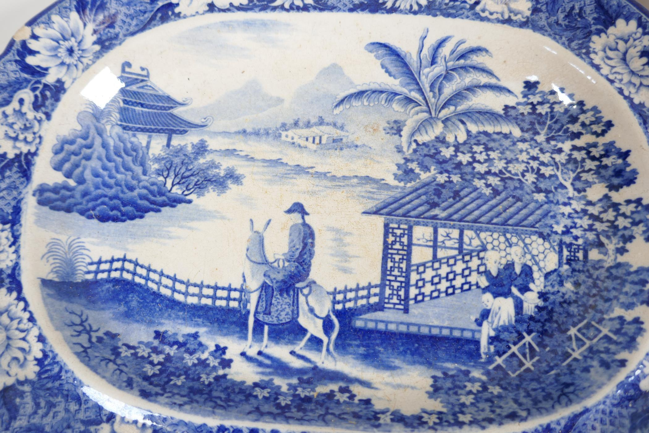"""C19th blue and white pottery 'Man on Donkey' pattern meat dish, 14"""" x 11"""", oval serving bowl and two - Image 2 of 5"""
