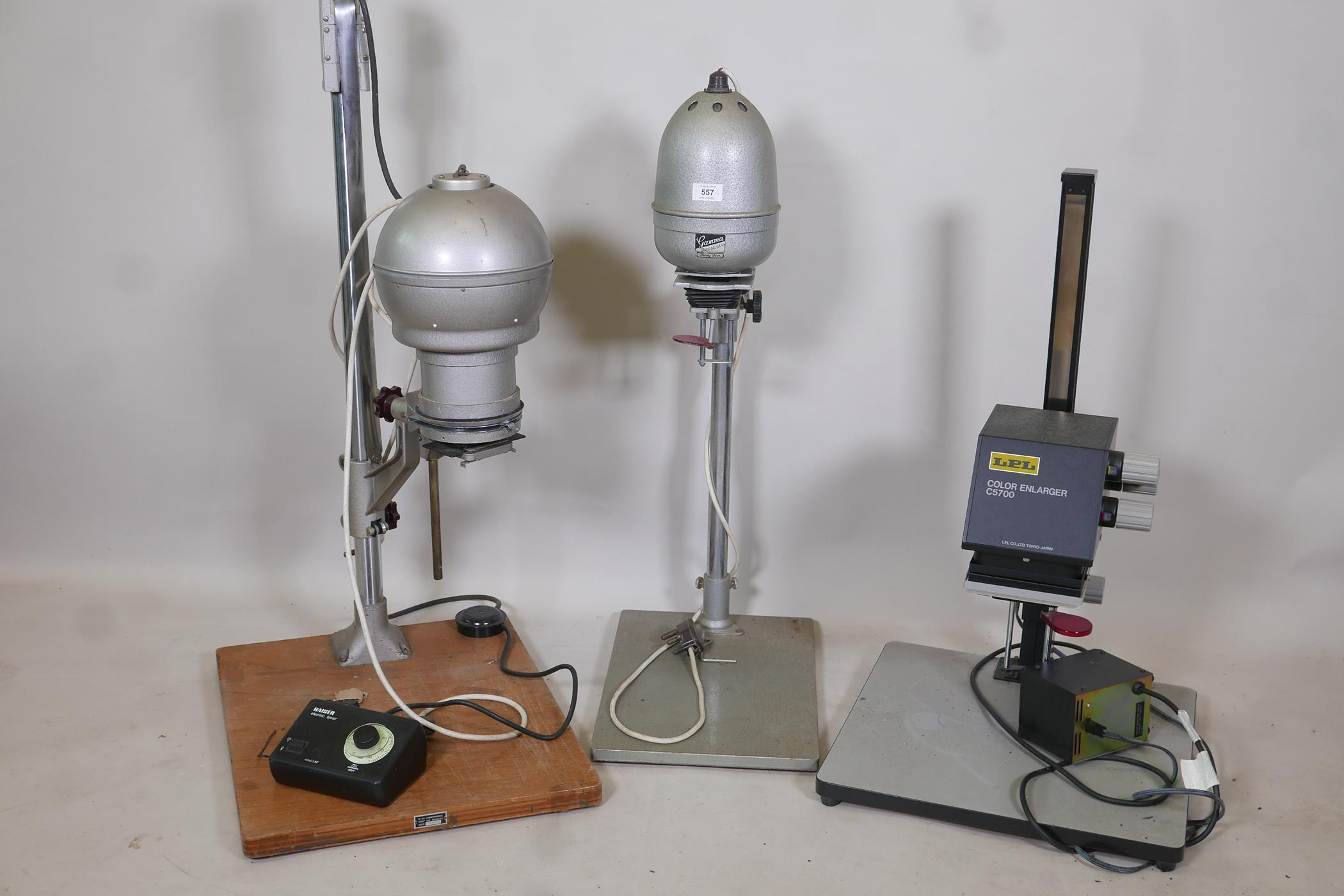 A Gamma 35 photographic enlarger, a LPL C5700 colour enlarger and another with timer