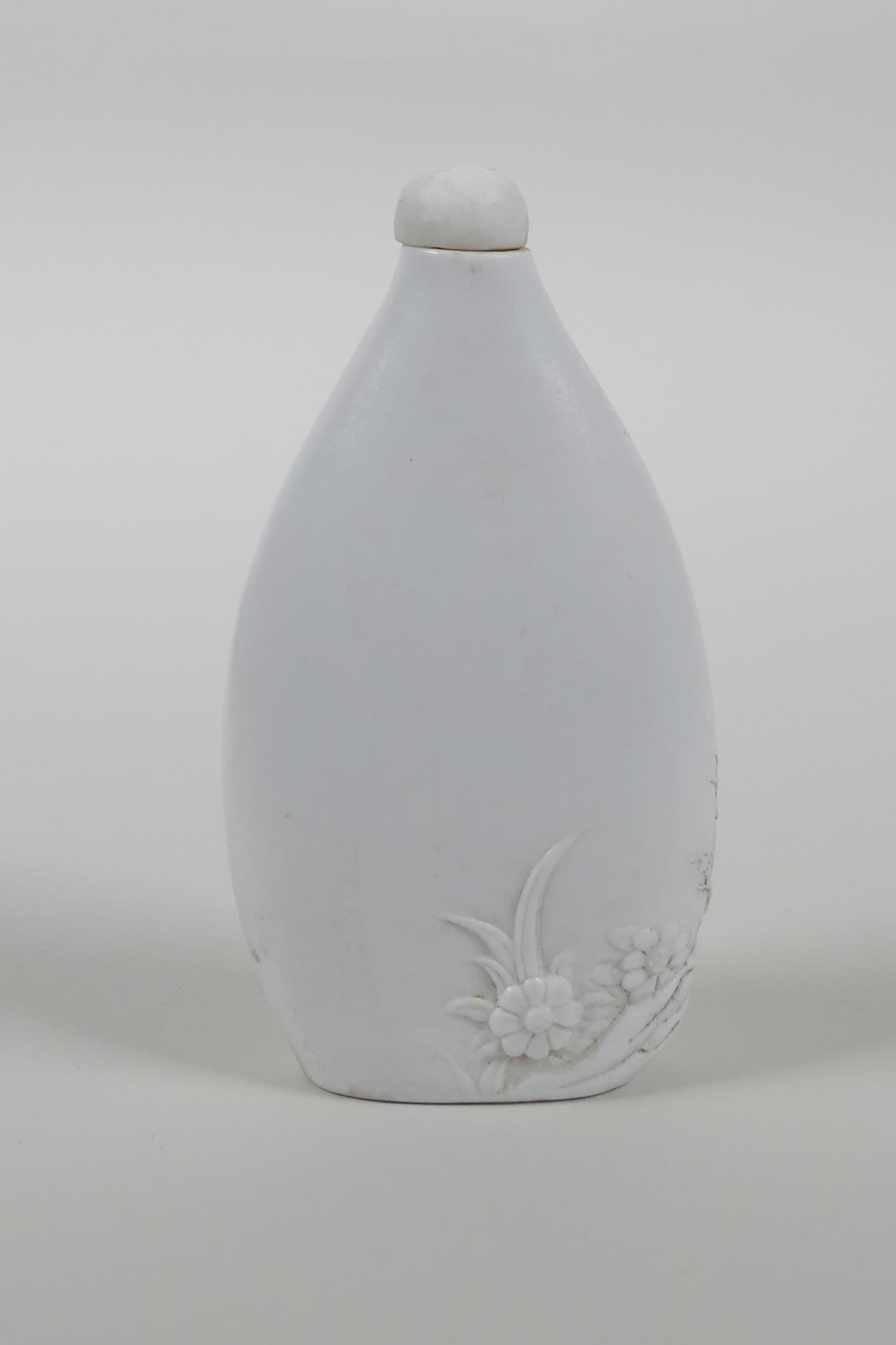 A Chinese hard paste snuff bottle with moulded cockerel decoration, impressed seal mark to base, - Image 2 of 3