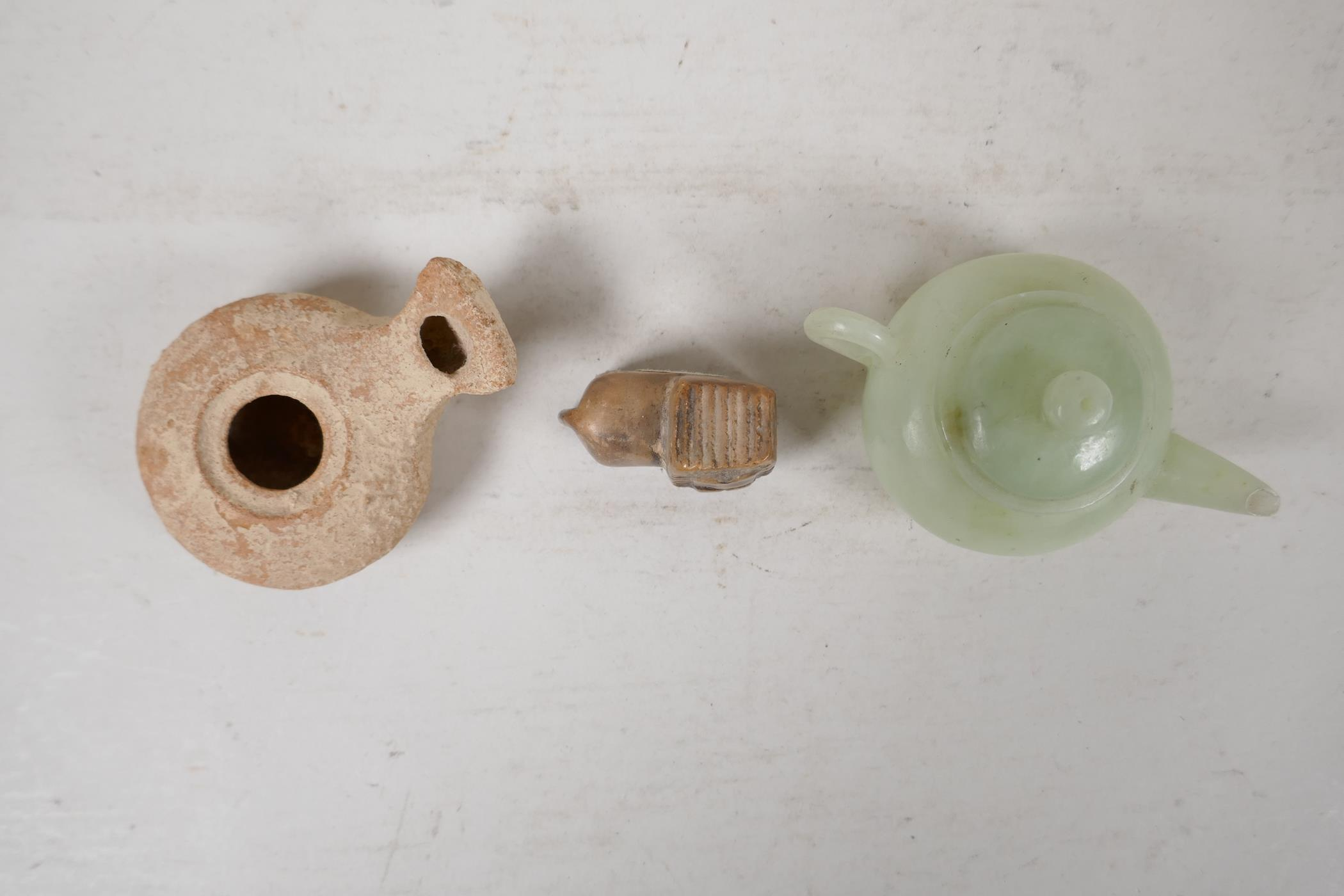 A Chinese carved green jade squat form teapot, Roman terracotta oil lamp, and a carved soapstone - Image 5 of 5