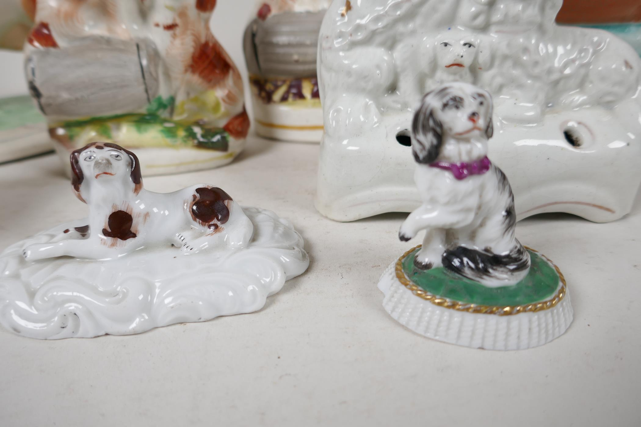 "Four Staffordshire flat back dog figures, largest 9"" high, a Staffordshire cow creamer, Beleek dog - Image 3 of 5"