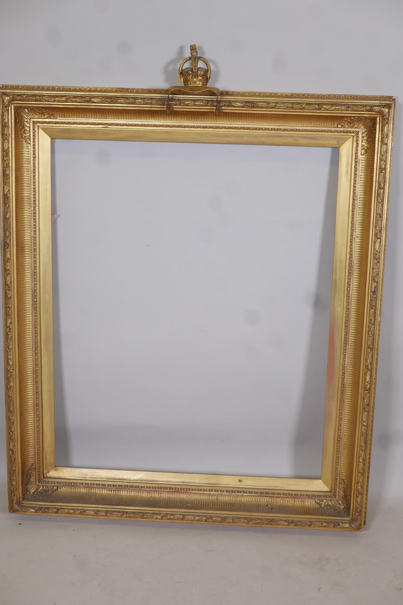 """A C19th gilt picture frame with crown and cushion finial, aperture 27"""" x 33"""""""