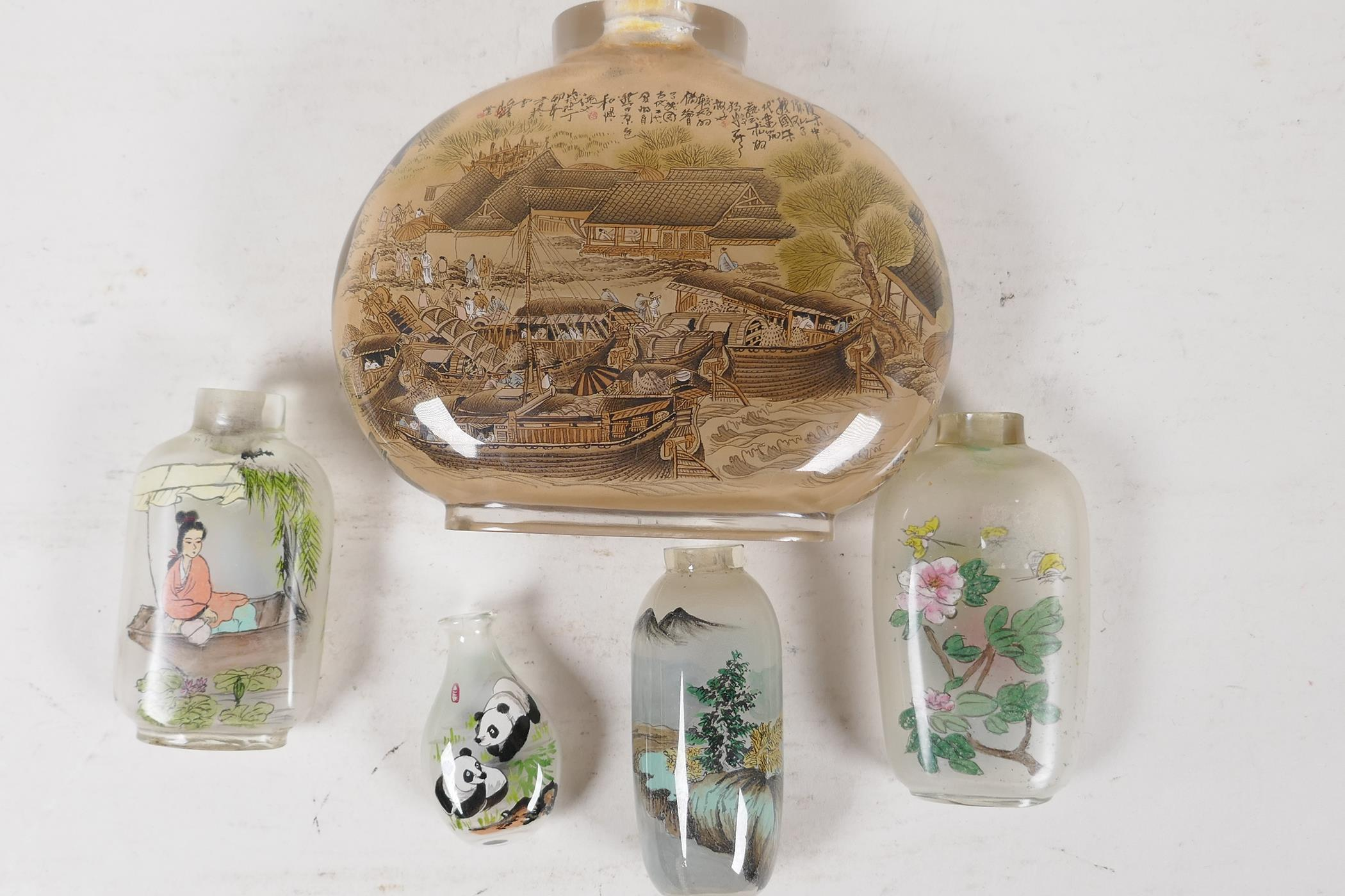 A large Chinese interior decorated snuff bottle depicting a harbour scene and figures on a bridge,