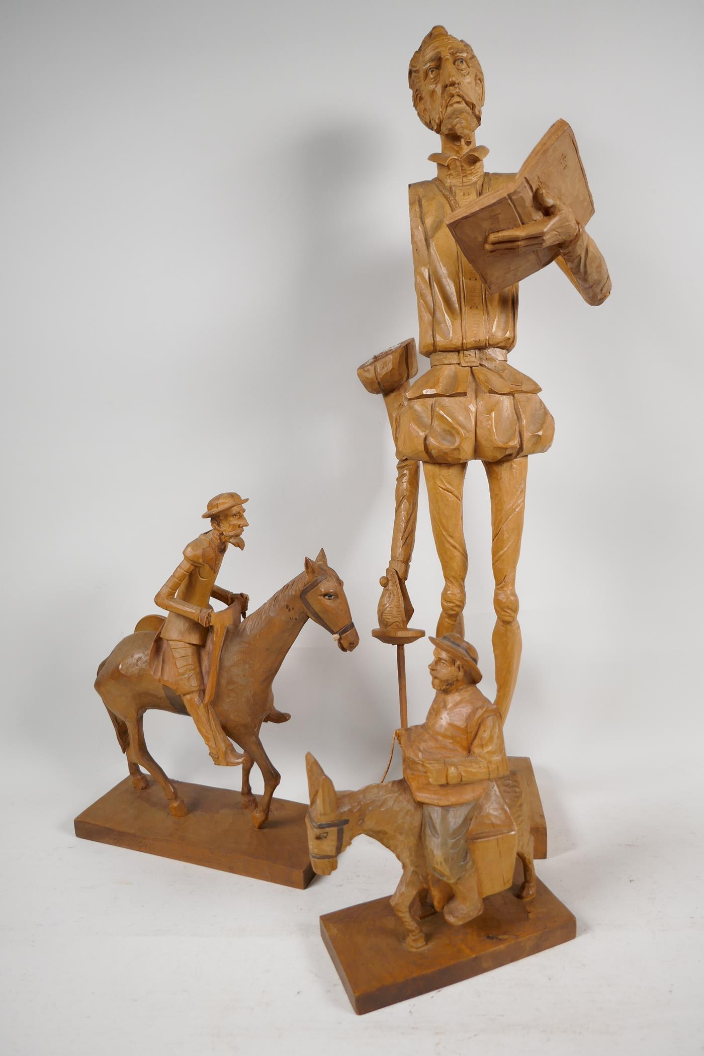 Two carved wood models of Don Quioxte and Sancho Panza, and a carved wood figure of the Don, A/F