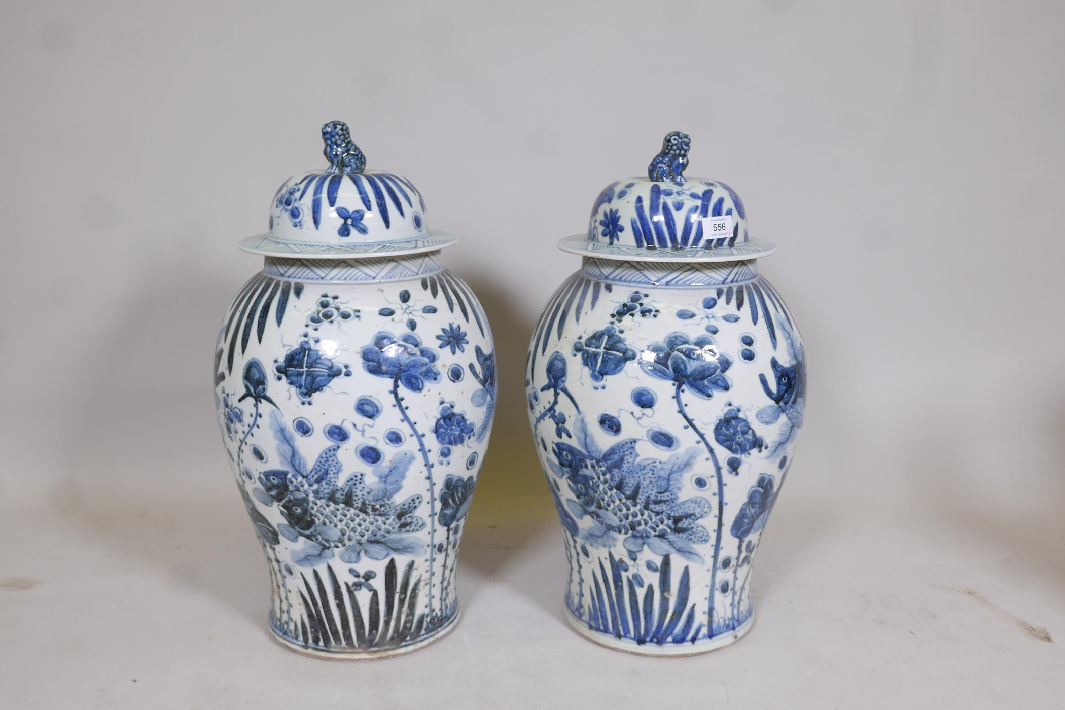 A pair of Chinese blue and white porcelain meiping jar and covers decorated with carp in a lotus - Image 3 of 5