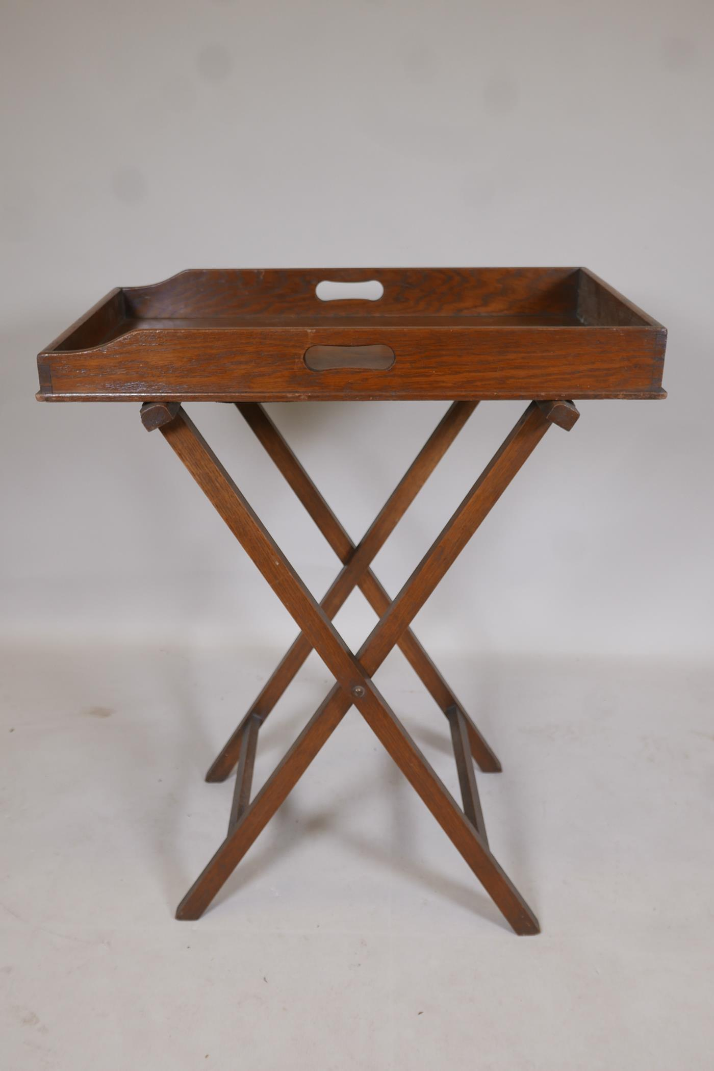 """A C19th oak butlers tray on stand, 33"""" x 27"""" x 17"""""""