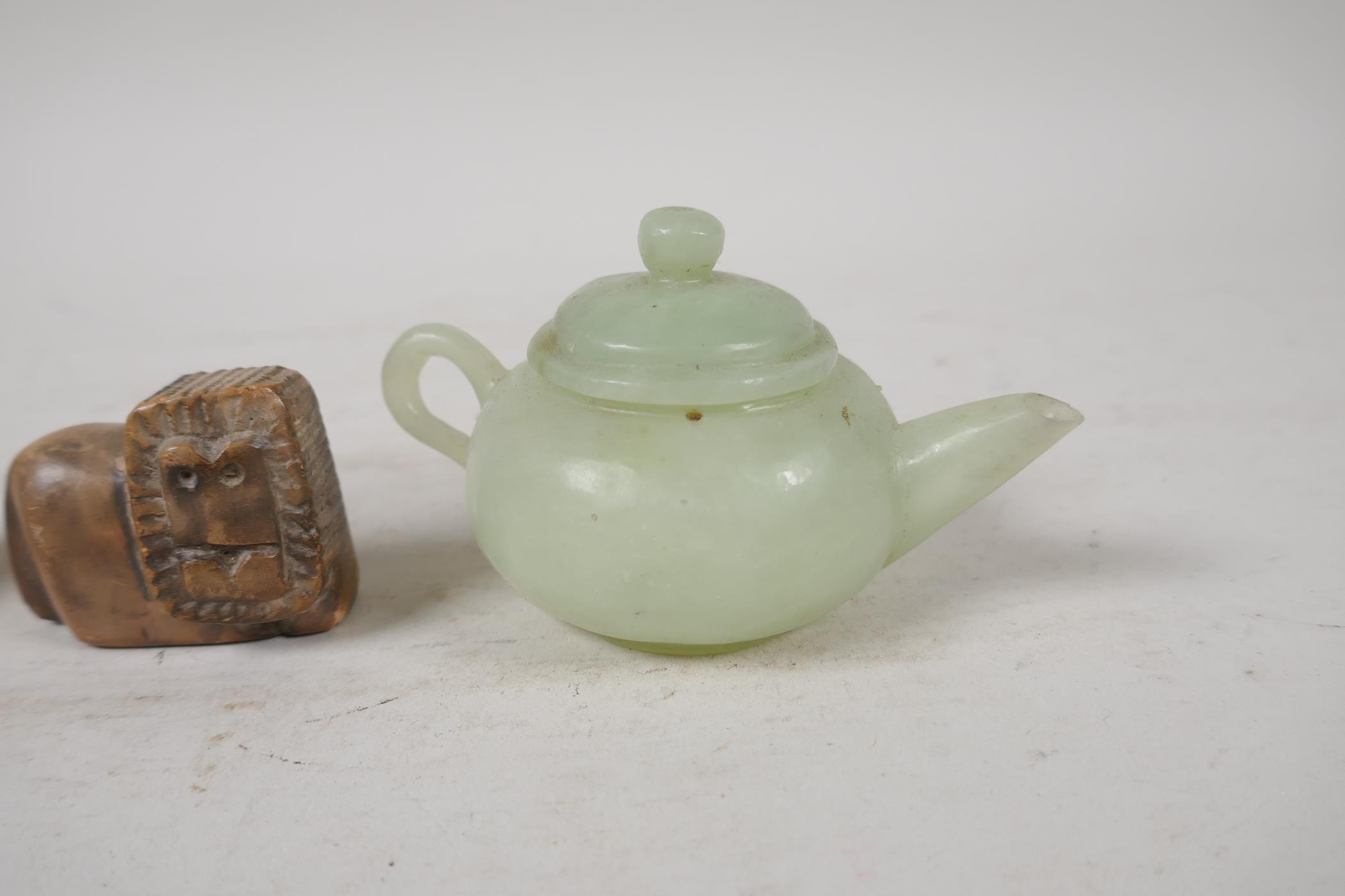A Chinese carved green jade squat form teapot, Roman terracotta oil lamp, and a carved soapstone - Image 3 of 5