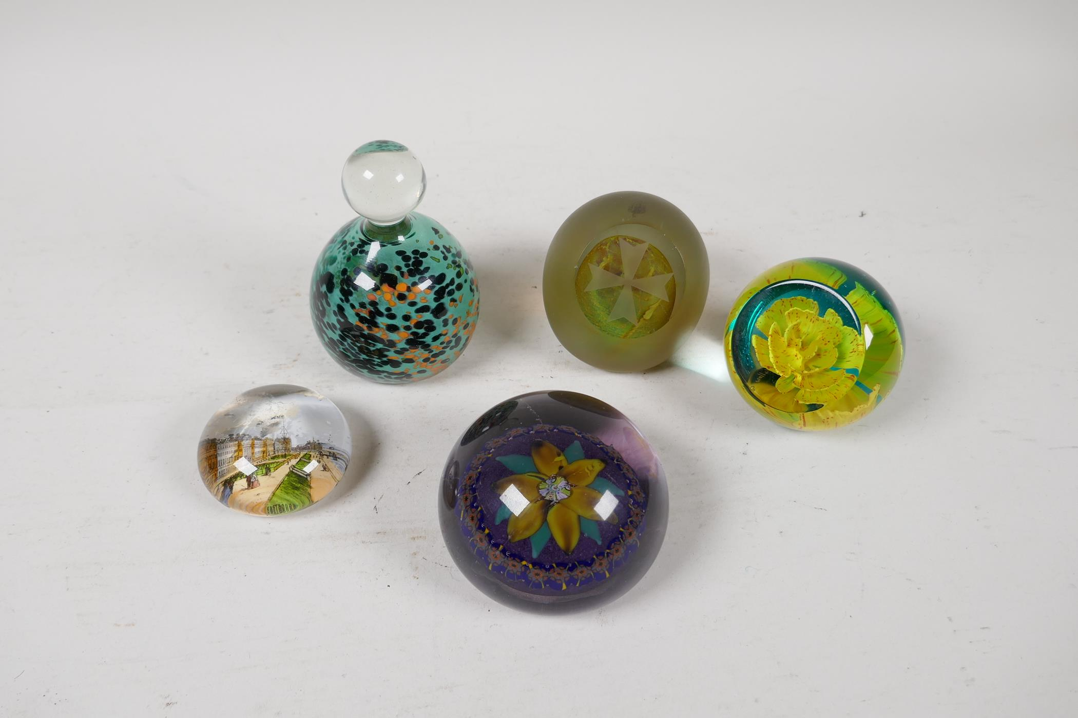 A 1930s Scottish floral glass paperweight by Salvador Ysart, a Caithness yellow carnation glass