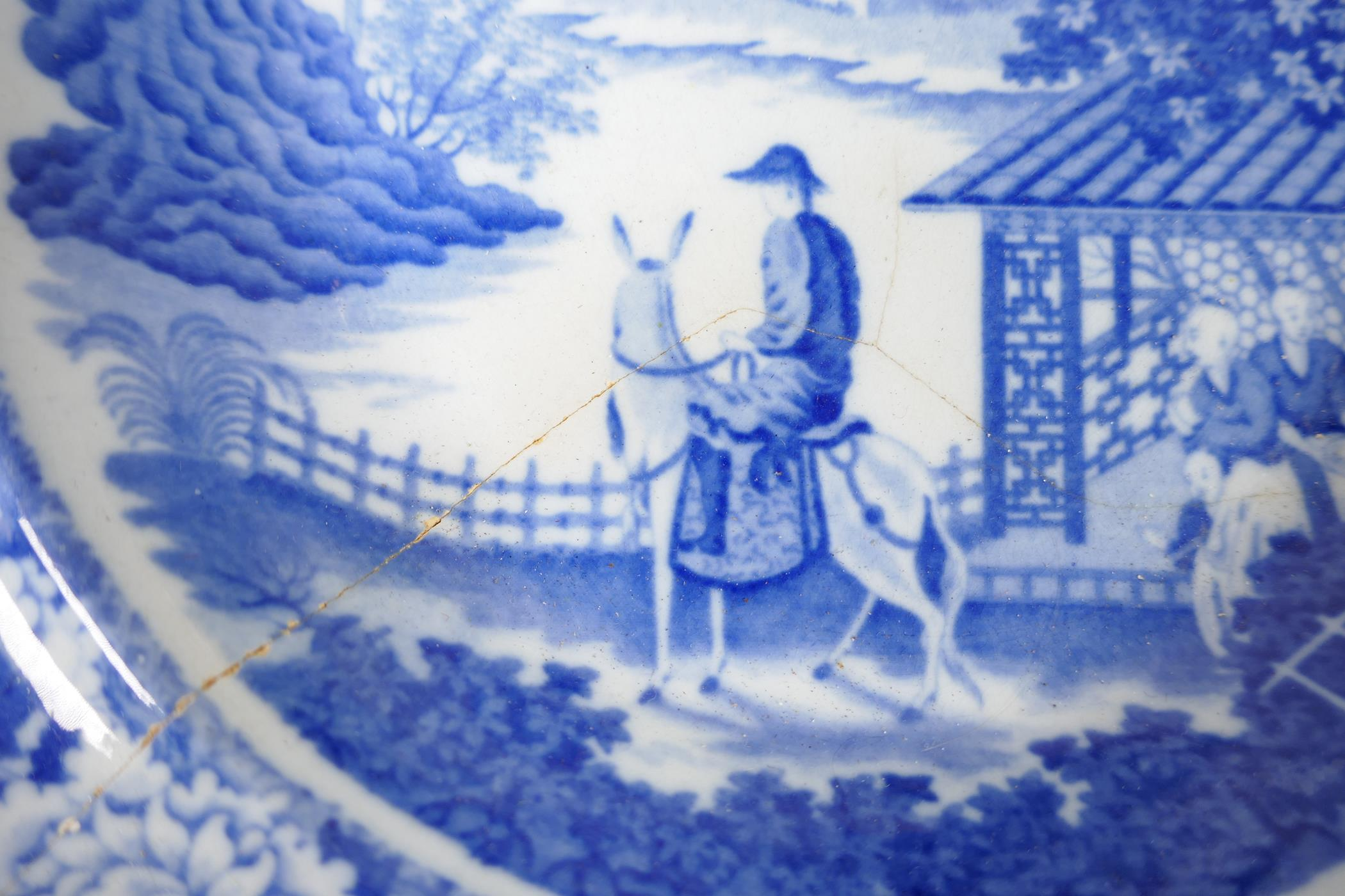 """C19th blue and white pottery 'Man on Donkey' pattern meat dish, 14"""" x 11"""", oval serving bowl and two - Image 5 of 5"""