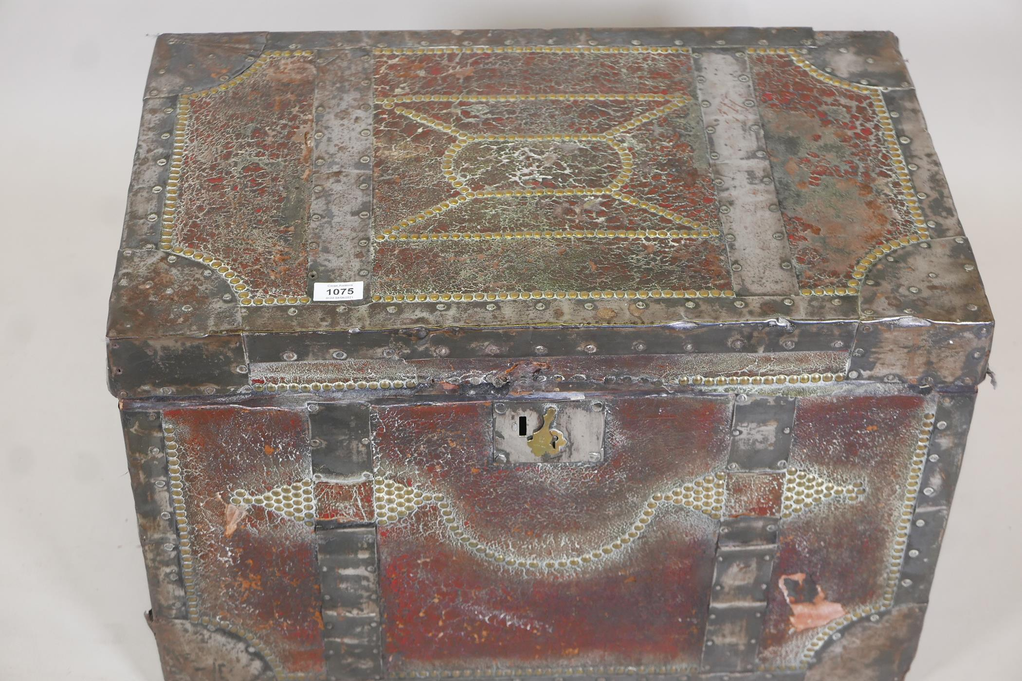 An early C19th painted leather trunk with brass stud decoration and steel straps, original papered - Image 3 of 5