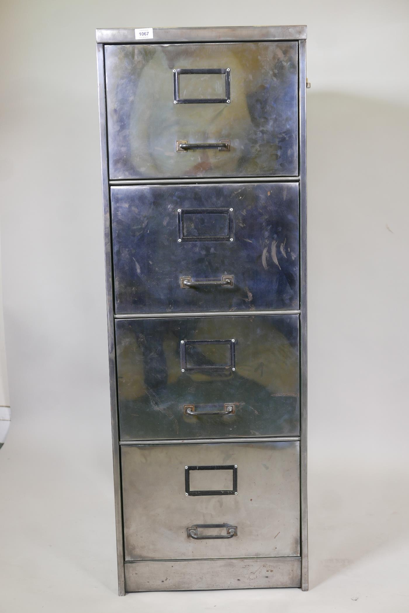 """A mid century stripped and polished metal four drawer filing cabinet, 1949 tag to the reverse, 18"""" x - Image 2 of 3"""