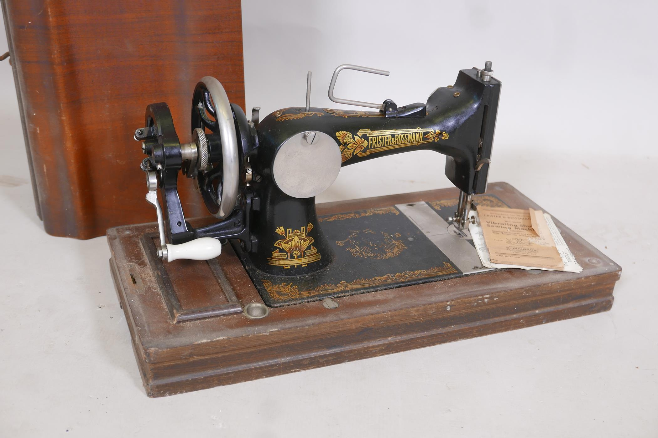 "A Frister & Rossman antique sewing machine in case, 21"" x 13"" x 10"""