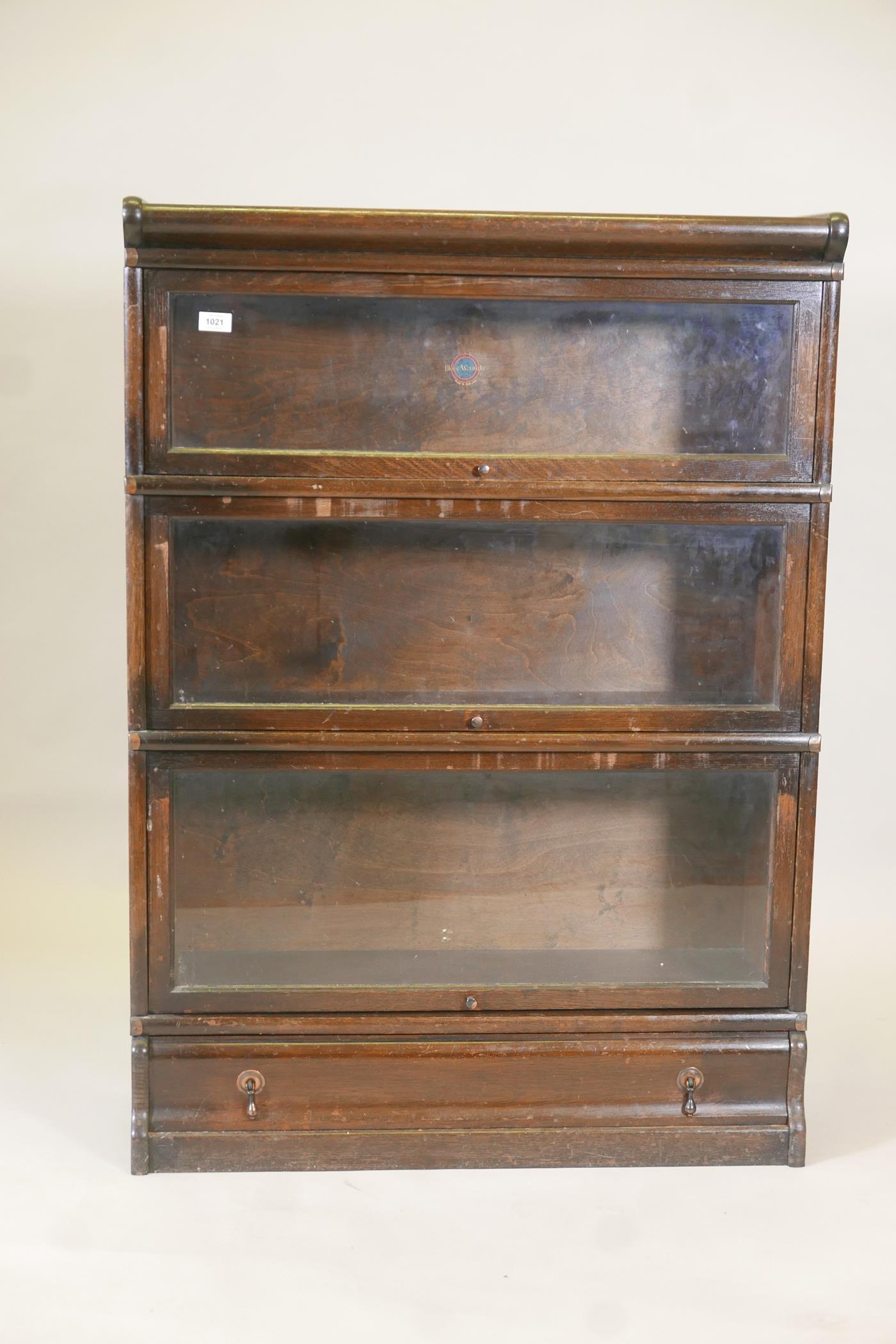 "A Globe Wernicke oak three section bookcase, 34"" x 12"", 47½"" high"