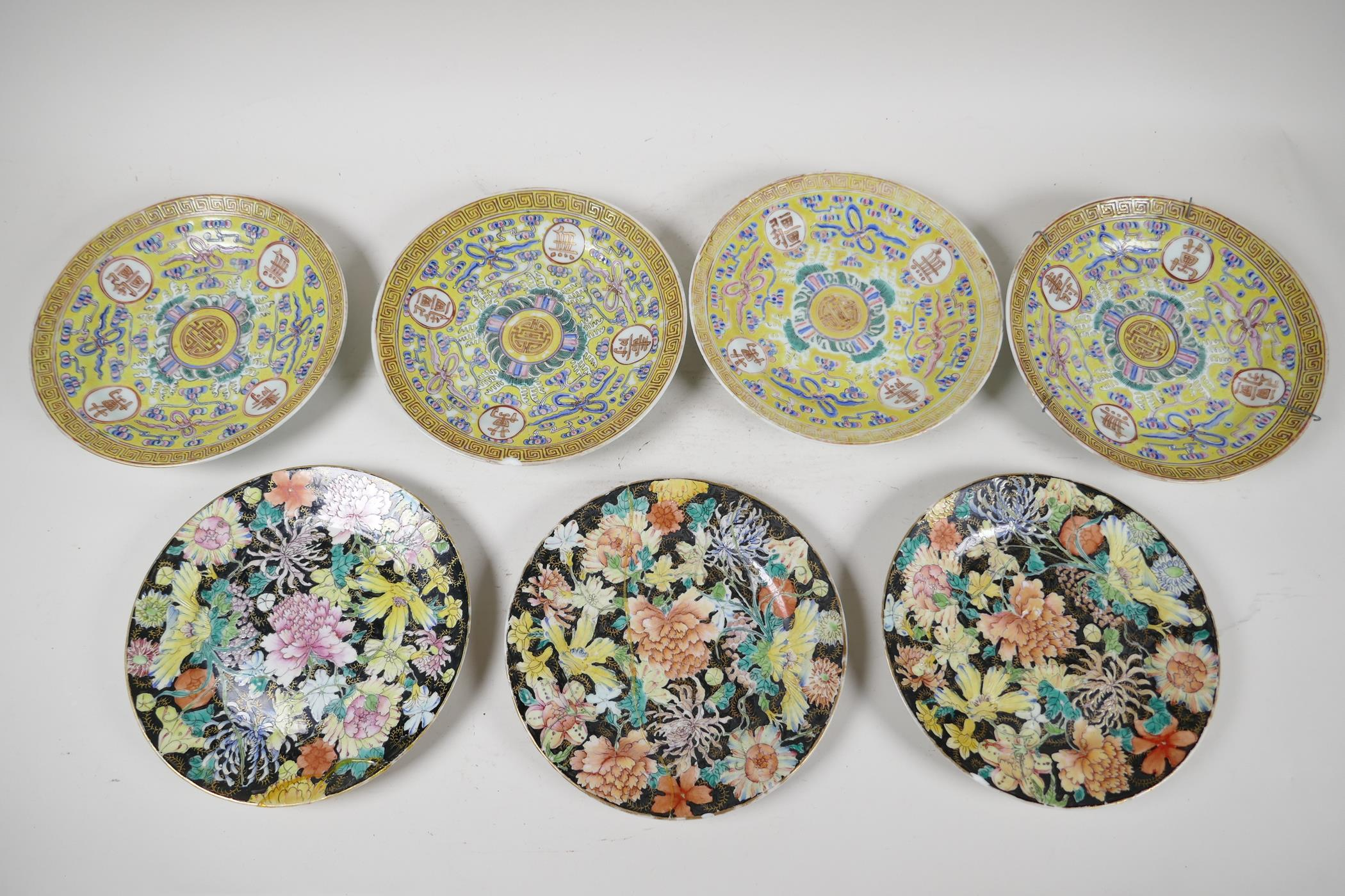 """Four late C19th Chinese porcelain plates decorated with symbols, on a yellow ground, 7"""" diameter,"""