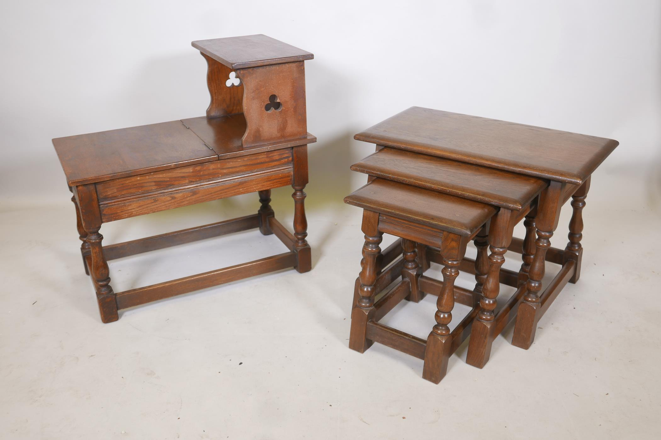 A nest of three oak tables on turned and splayed supports, together with an oak telephone table,
