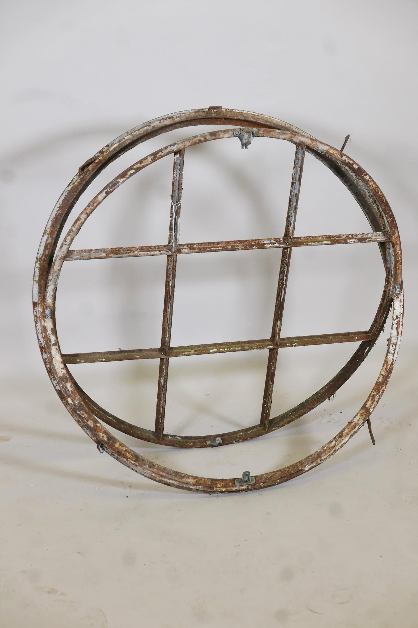 """Architectural salvage, a painted metal window frame, 36"""" diameter"""