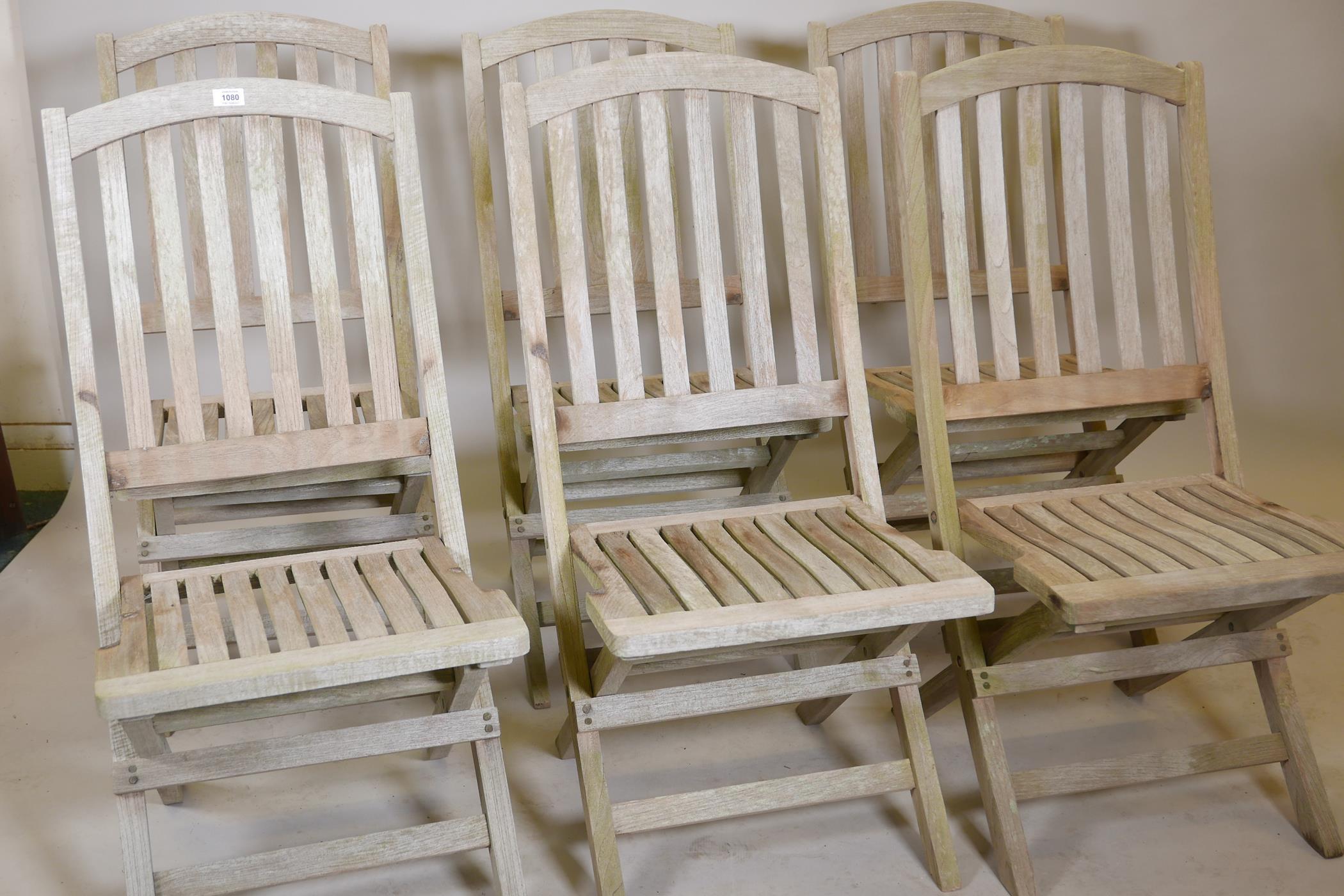 A set of six Heal's teak folding garden chairs