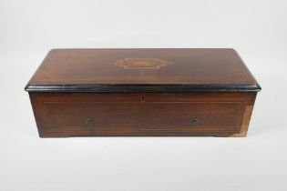 A C19th Swiss rosewood veneered music box with cross banded inlay, playing 6 aires, lacks melody