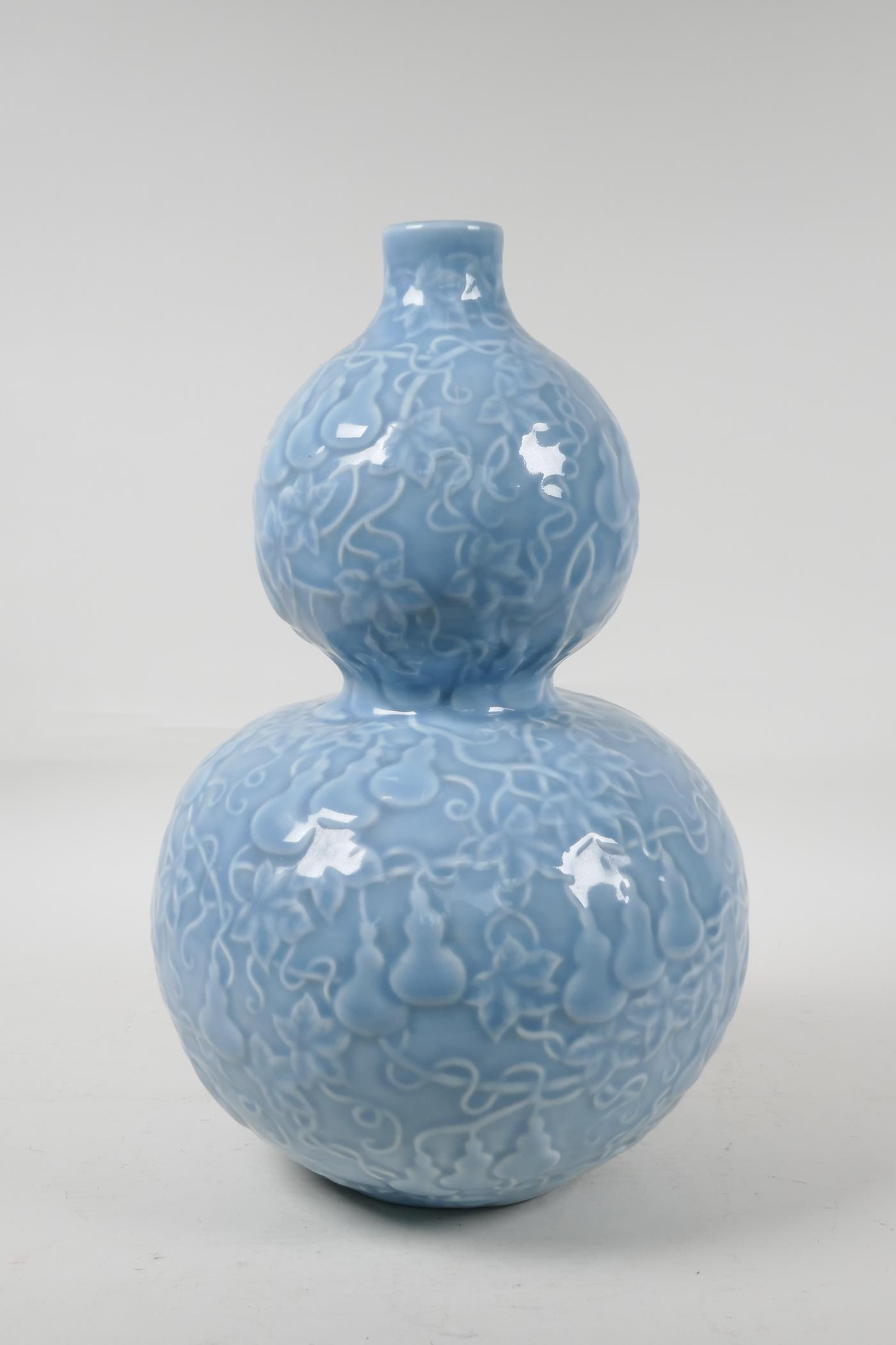 A Chinese blue glazed porcelain double gourd vase, with all over raised gourd vine decoration, - Image 2 of 4