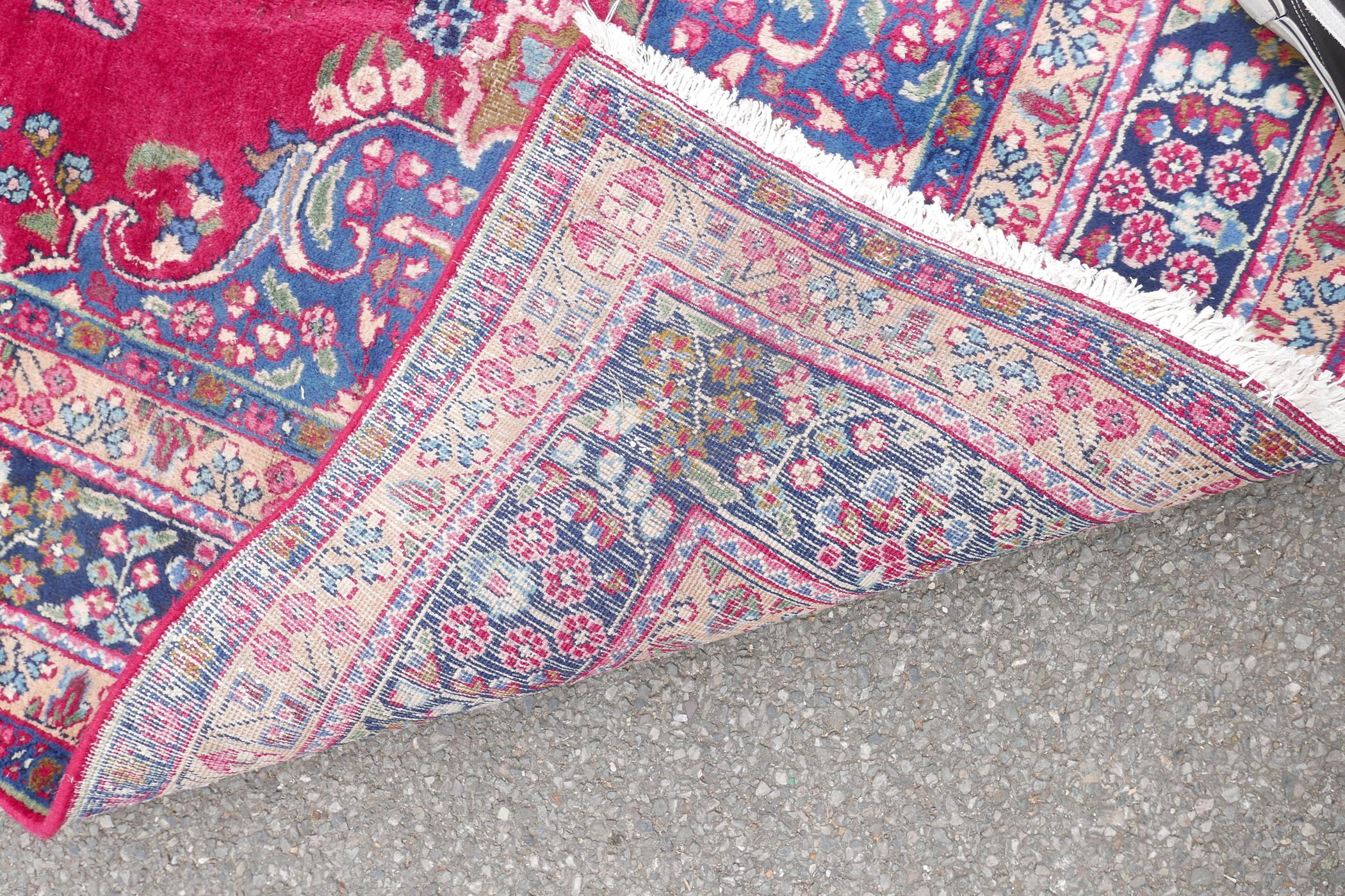 """A pink/red ground Persian Kashmar carpet with a floral medallion design, 77"""" x 117"""" - Image 7 of 7"""