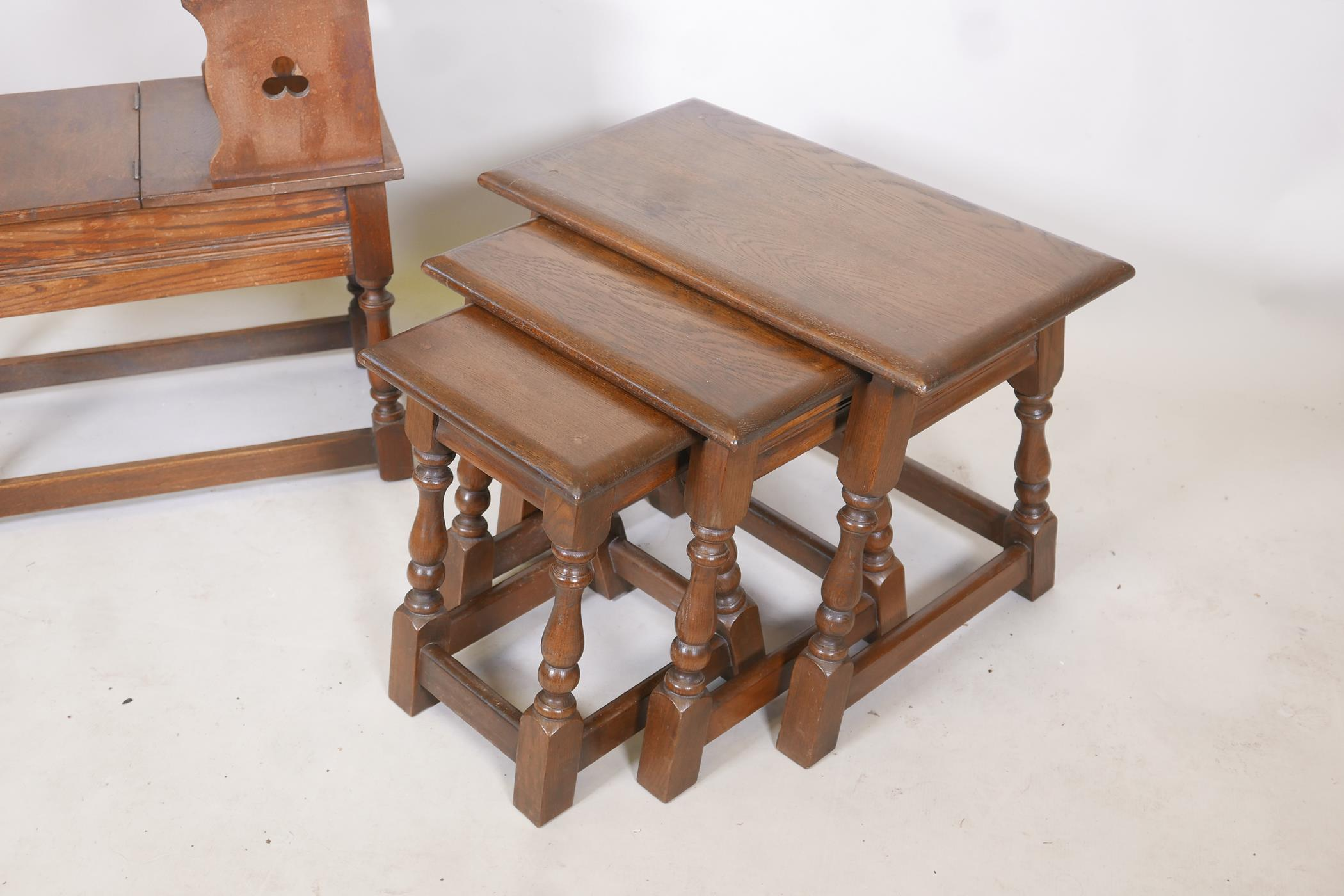 A nest of three oak tables on turned and splayed supports, together with an oak telephone table, - Image 2 of 3