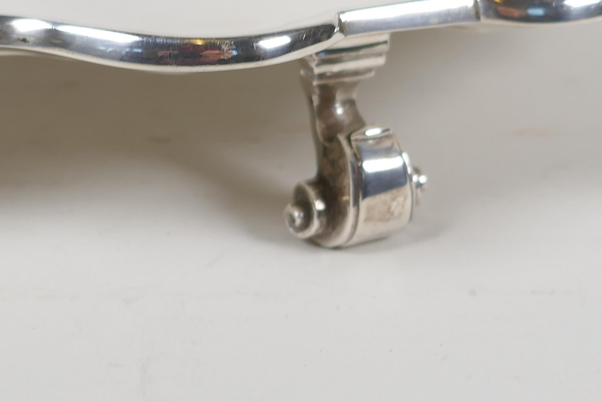 A hallmarked silver serving tray with gadrooned rim, on three cast scroll supports, hallmarked - Image 3 of 5
