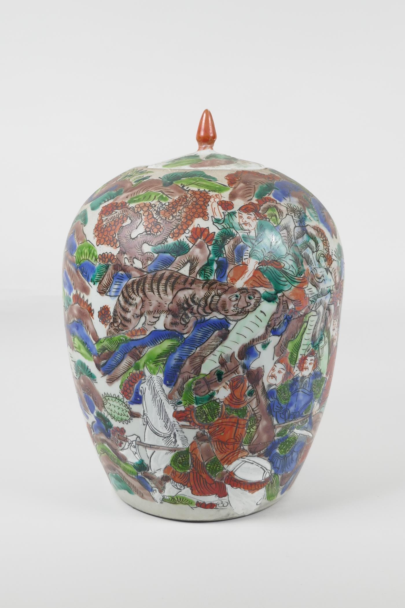 """A Chinese famille vert porcelain ginger jar and cover, decorated with a tiger hunting scene. 12"""""""
