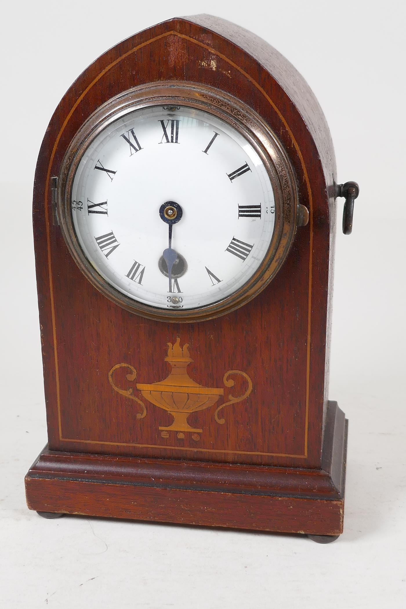 """An inlaid mahogany cased lancet mantel clock with enamelled dial and Roman numerals, 8"""" high"""