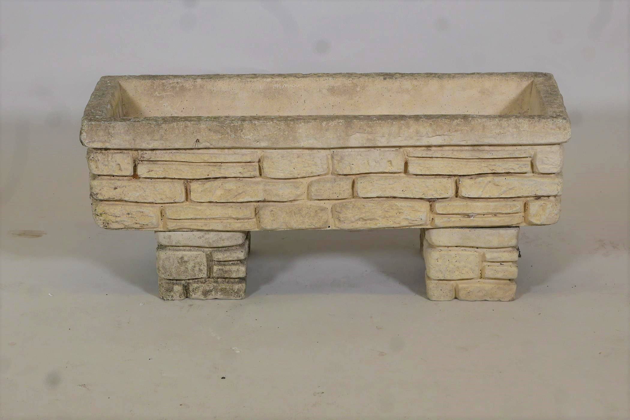 """A reconstituted stone planter moulded as Cotswold stone, 30"""" x 10"""""""