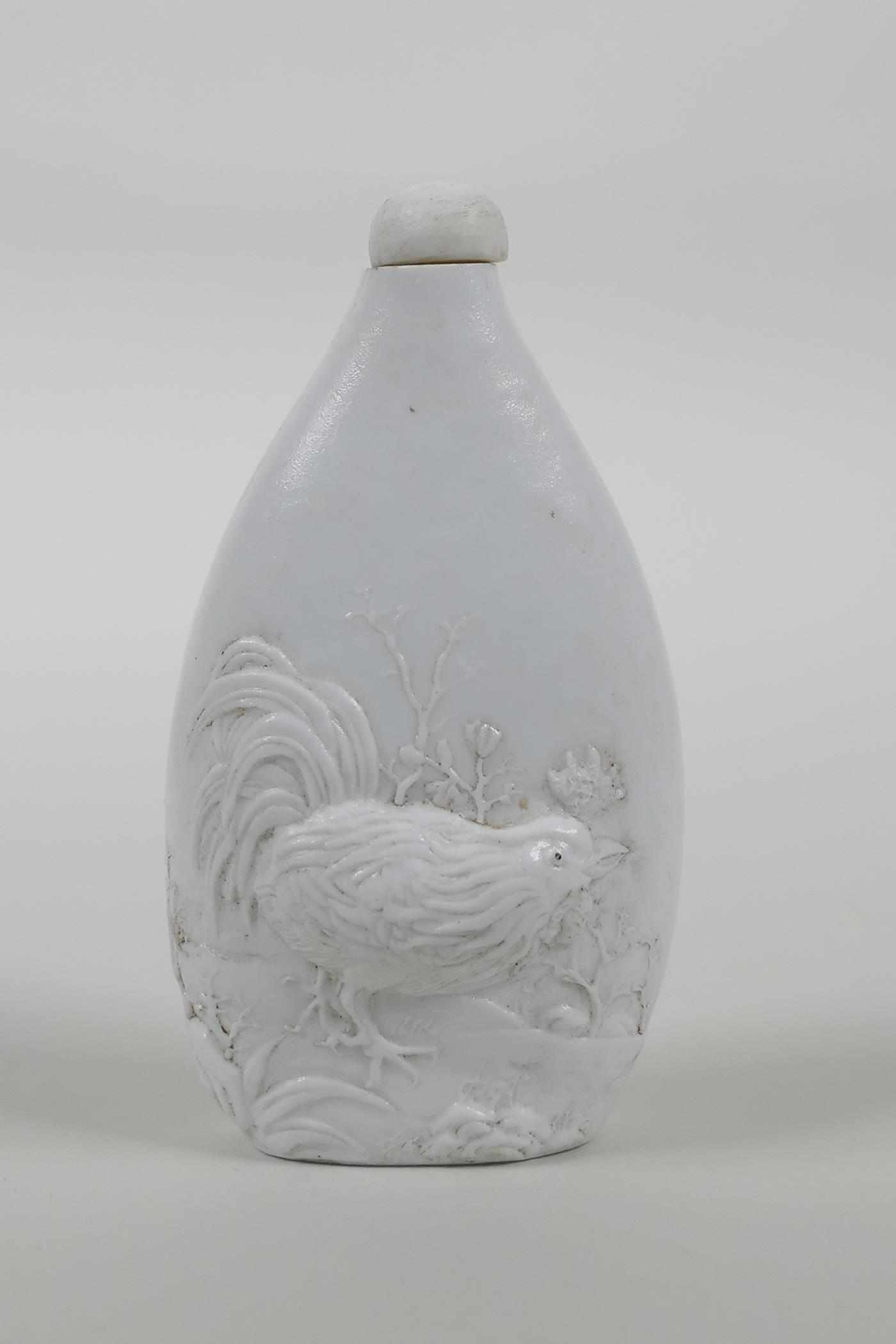 A Chinese hard paste snuff bottle with moulded cockerel decoration, impressed seal mark to base,