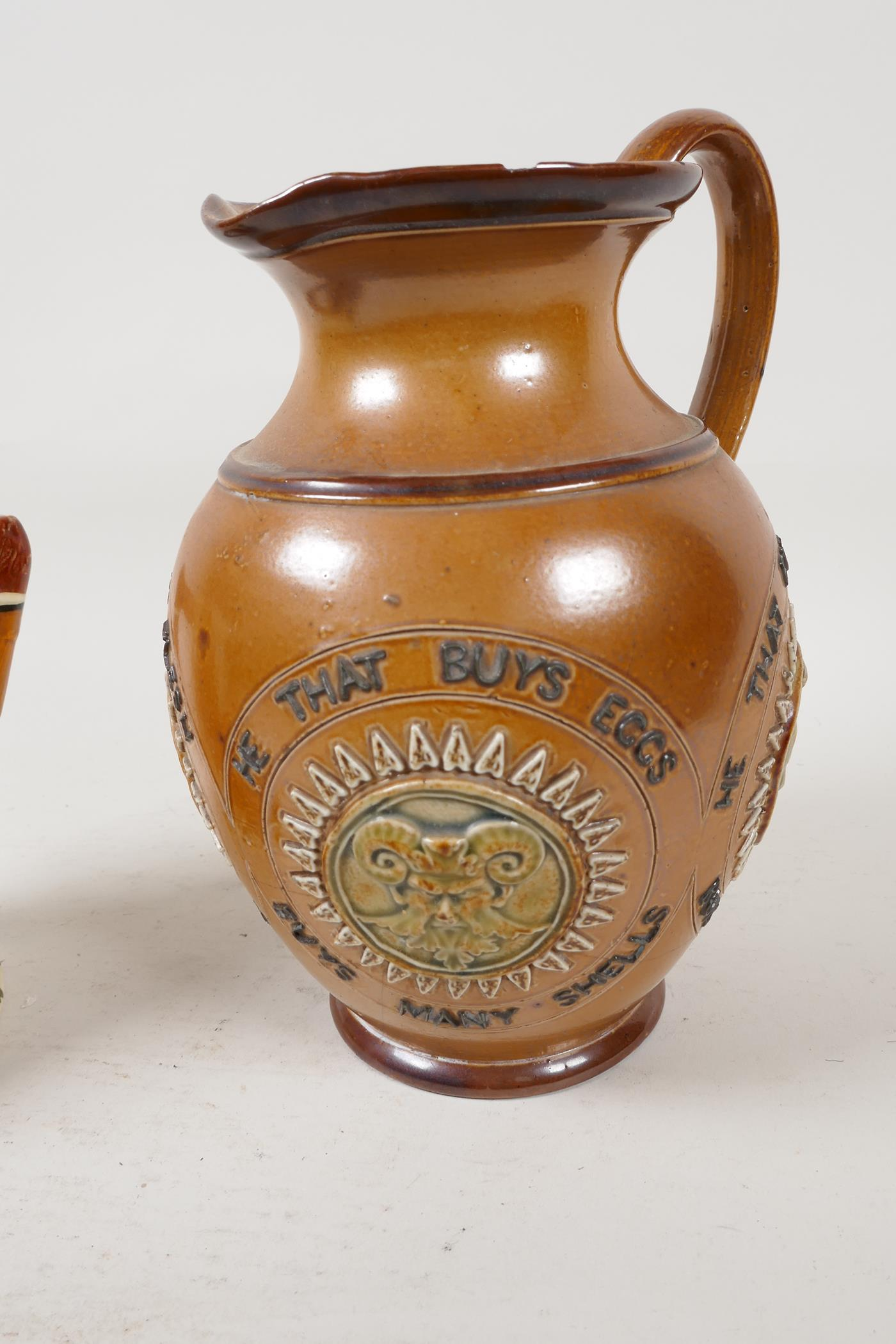 A Doulton Lambeth stoneware jug bearing the legend 'He that buys good ale' embossed with various - Image 3 of 5