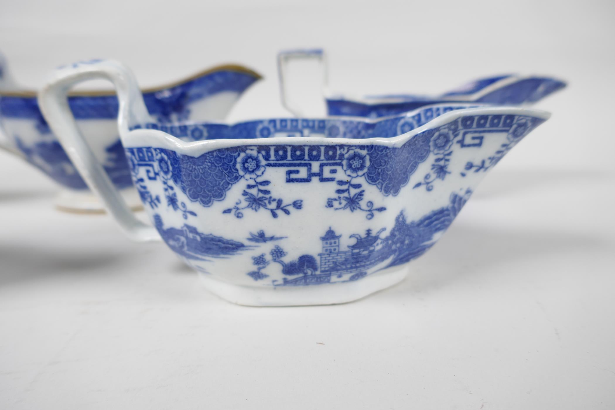 Five late C18th/early C19th English blue and white pottery sauce boats to include Boy on a Buffalo - Image 2 of 9