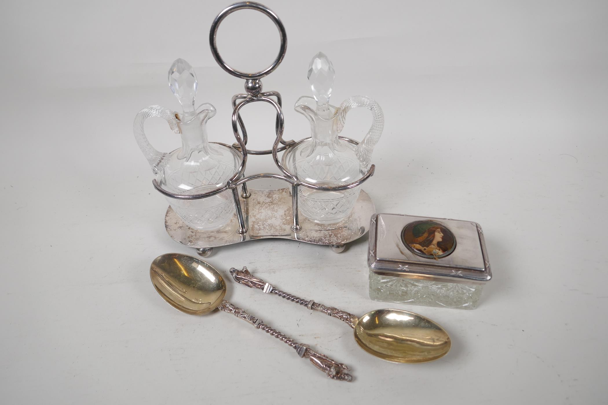 """A silver plate and glass oil and vinegar cruet set, 9"""" high, together with a pair of silver plate"""