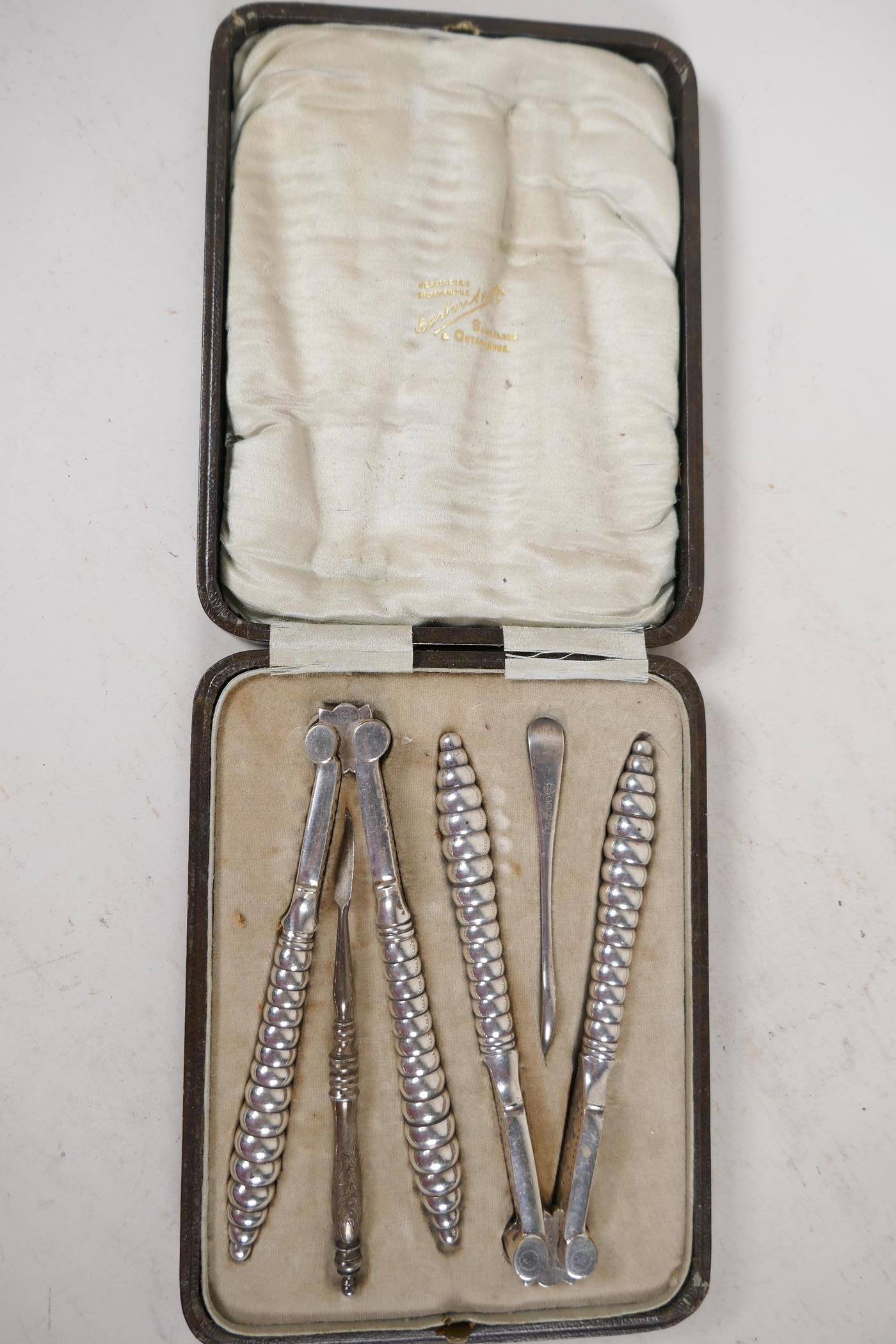 """A boxed set of C19th silver plated shellfish tools and crackers, 5½"""" long - Image 2 of 2"""