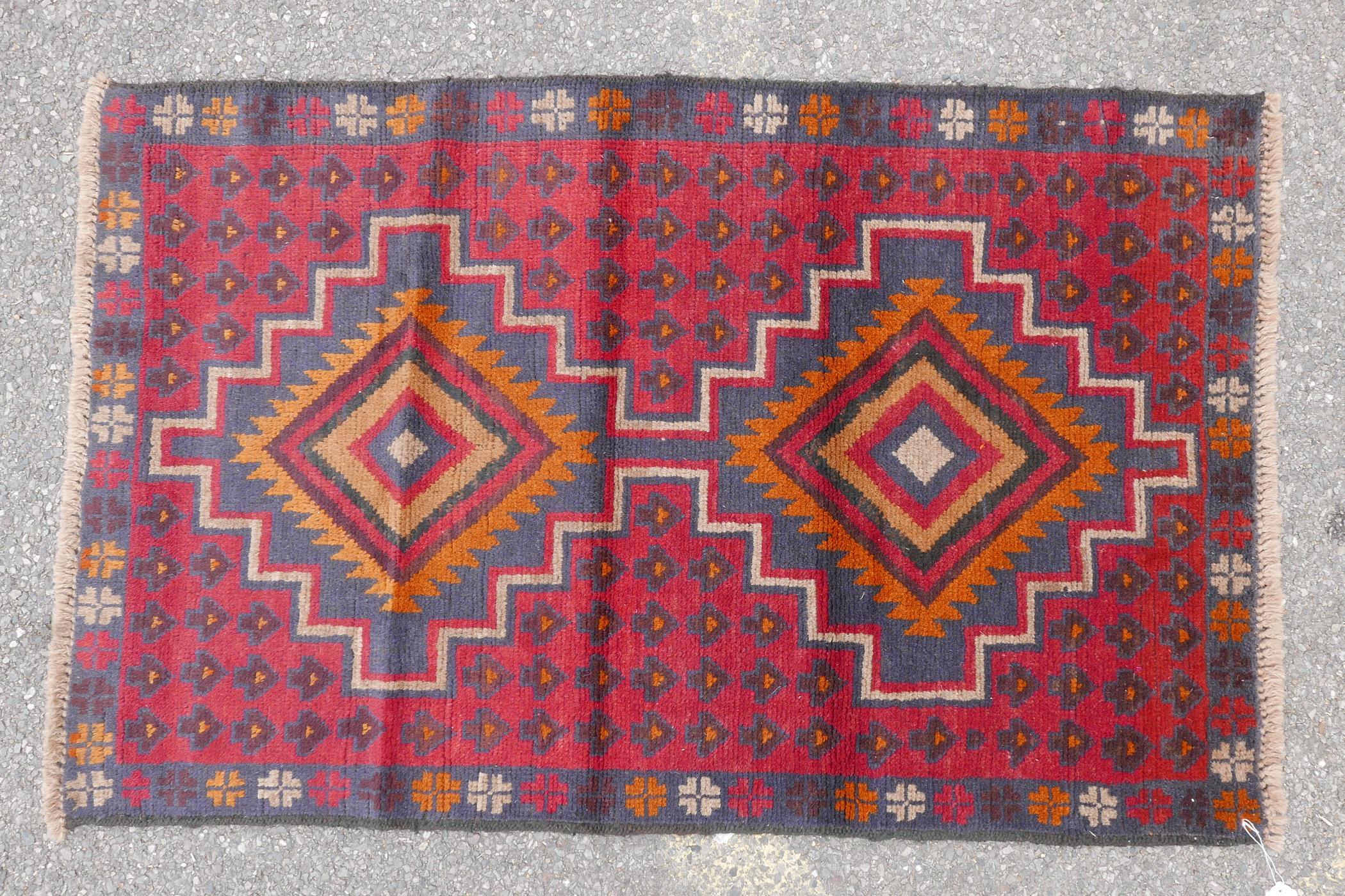 "Full pile red ground Afghan Belouch nomadic rug, 35"" x 56"""